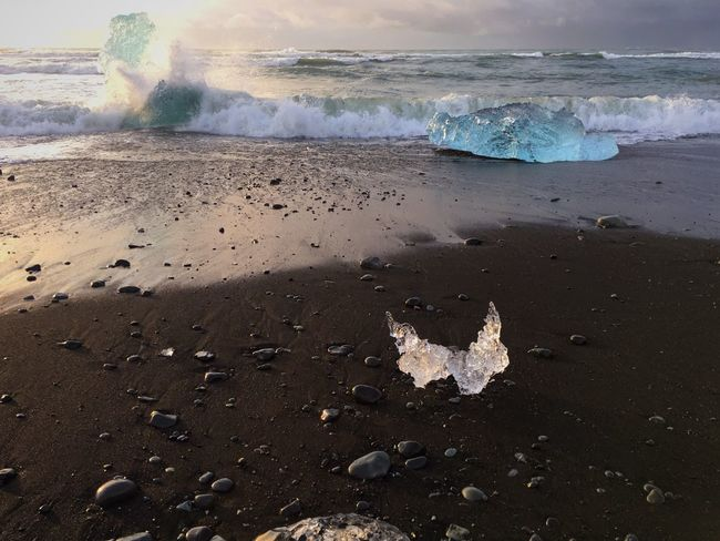 Ice Age Icebergs Water Travel Destinations Tourism Tranquility Scenics Tranquil Scene Nature Sea Beauty In Nature Physical Geography Non-urban Scene Power In Nature Wave Majestic Geology Outdoors Cloud - Sky Tide Shore Sky Iceland