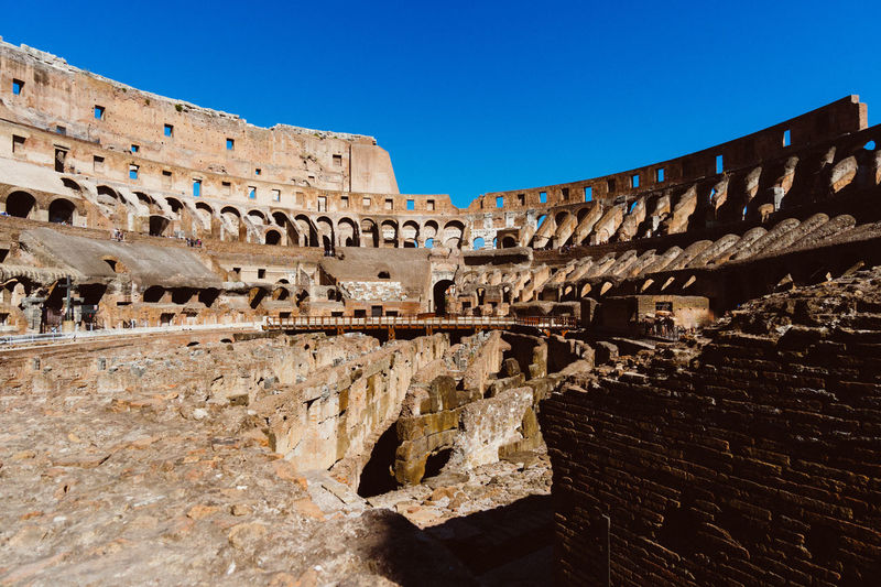 Colosseum IV Amphitheater Ancient Ancient Civilization Archaeology Architecture Blue Built Structure Clear Sky Day History Low Angle View No People Old Ruin Outdoors Sky Sunlight The Past Tourism Travel Travel Destinations
