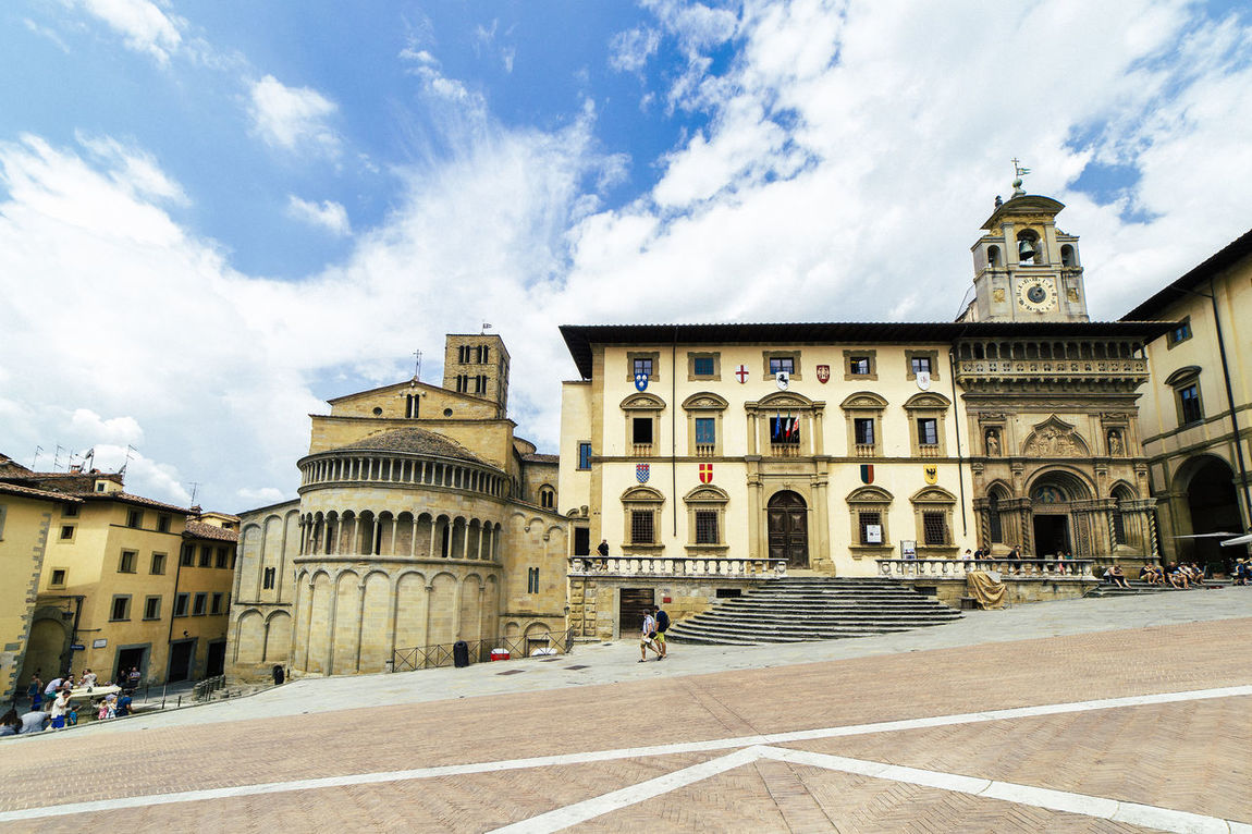 The Piazza Grande square, located in the old town of Arezzo, Tuscany, Italy. Ancient Architecture Arezzo Building Exterior Built Structure Church City Cloud - Sky Day Façade Historic History Italy Old Town Outdoors People Piazza Grande Sky Square Travel Destinations Tuscany