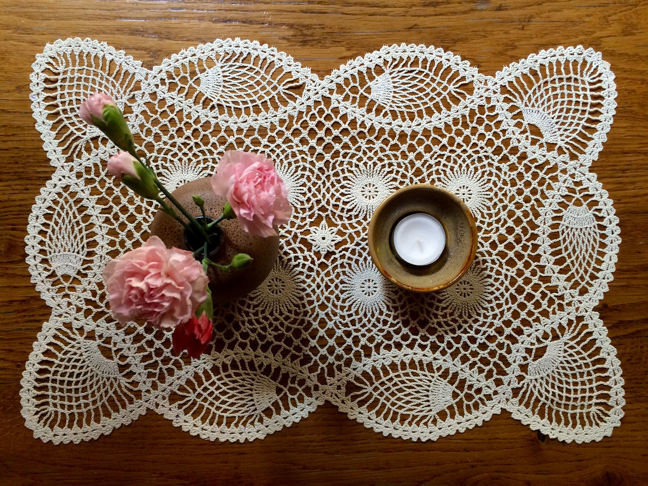 table, high angle view, flower, indoors, no people, wood - material, food and drink, freshness, close-up, fragility, day, flower head, nature