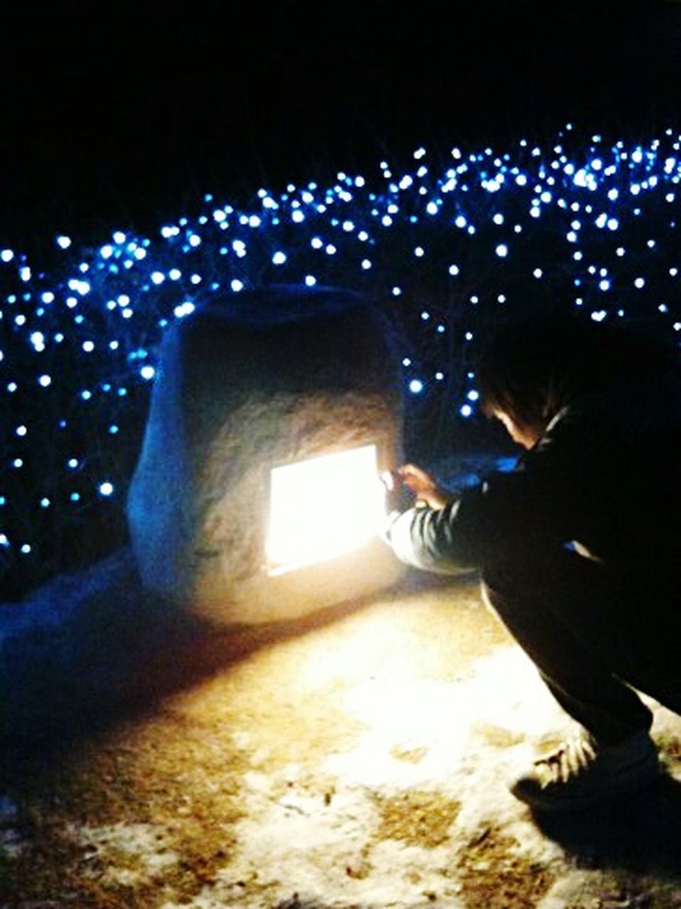 illuminated, night, people, side view, winter, one person, christmas, cold temperature, discovery, outdoors, child, full length, christmas decoration, children only, neon, adult, star - space, tree, one boy only, young adult, warm clothing