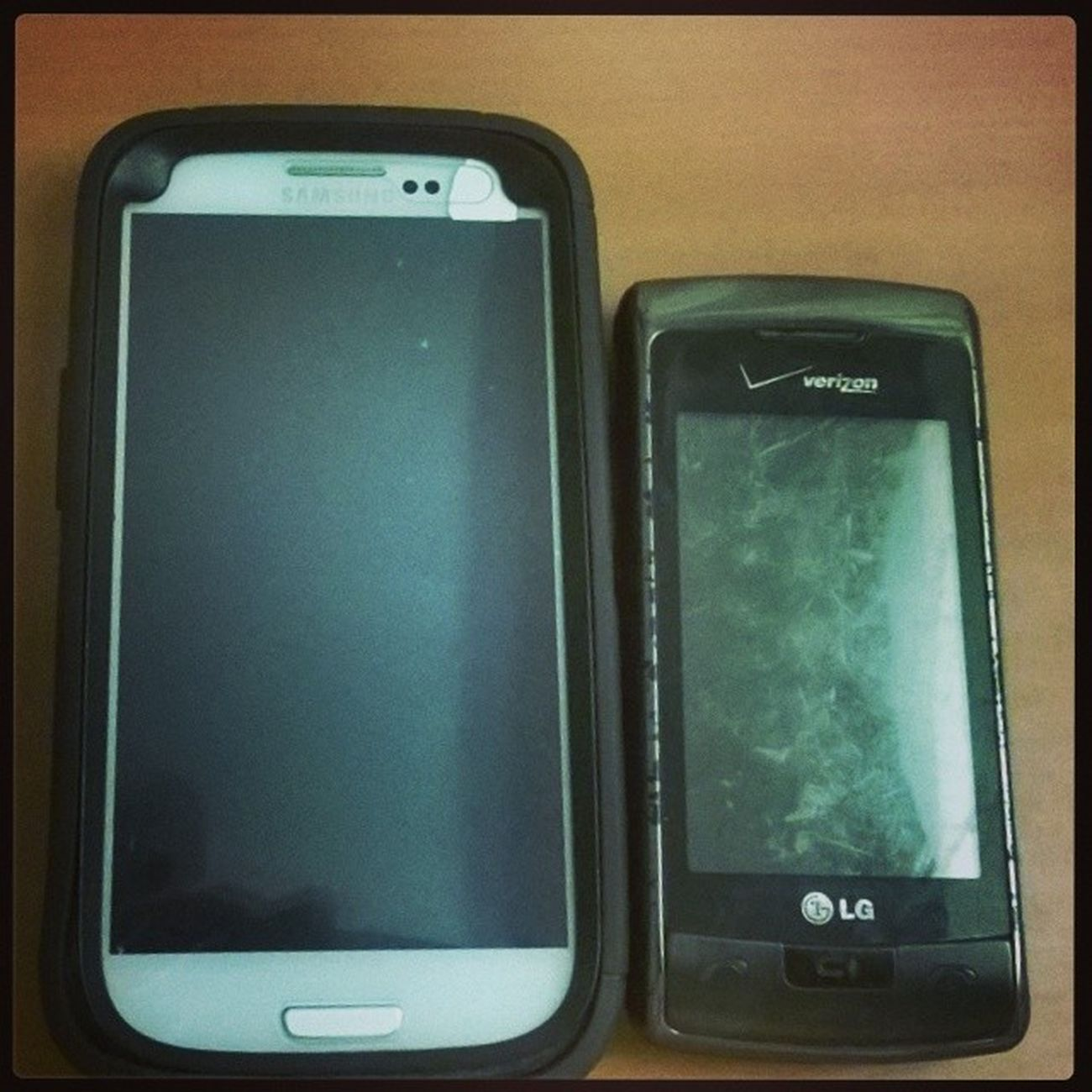 My SGS3 & my LG Envy 9800. What a difference! The Envy was considered big in ir day. Instapic Instadaily Instagram Instaandroid InstaLg Instaphone Android Verizon Boostmobile