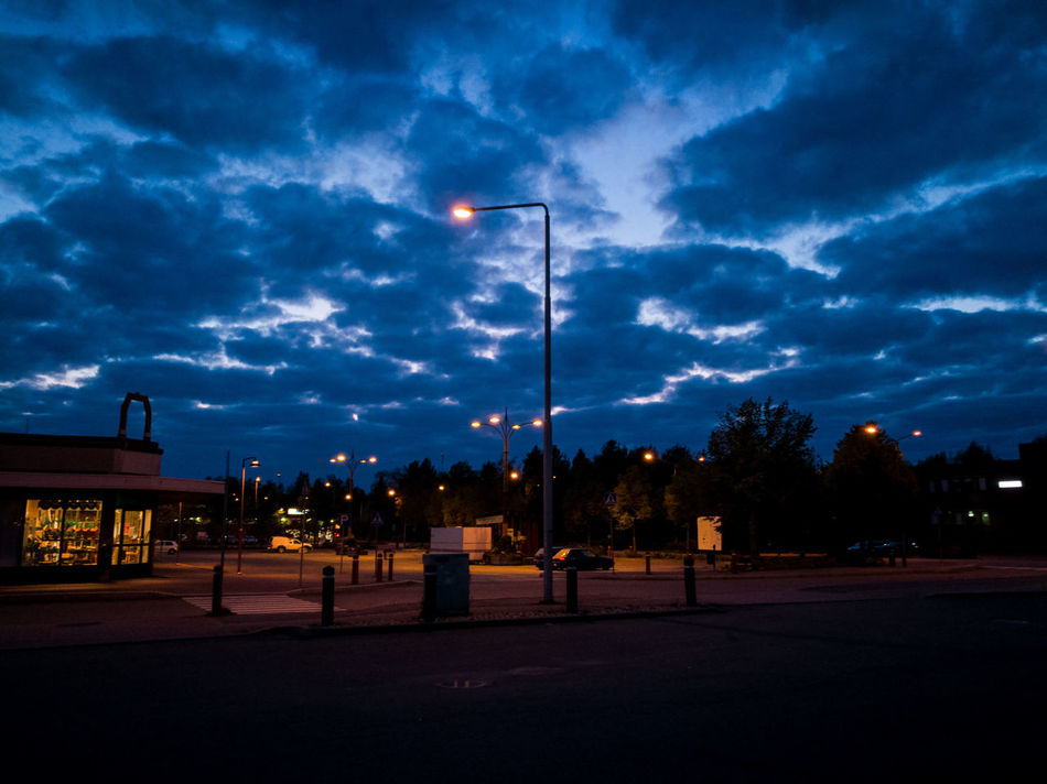 Street Light Sky Building Exterior Outdoors Lamp Post Floodlights Dark Electric Light Cloud - Sky Small Town Marketplace Quiet Night Lights Night Photography Empty Market Opposite Colours Blue Orange Blue Sky Sodium Light Small Town Living Parting Clouds Dusk Dusk Colours Dusky Sky