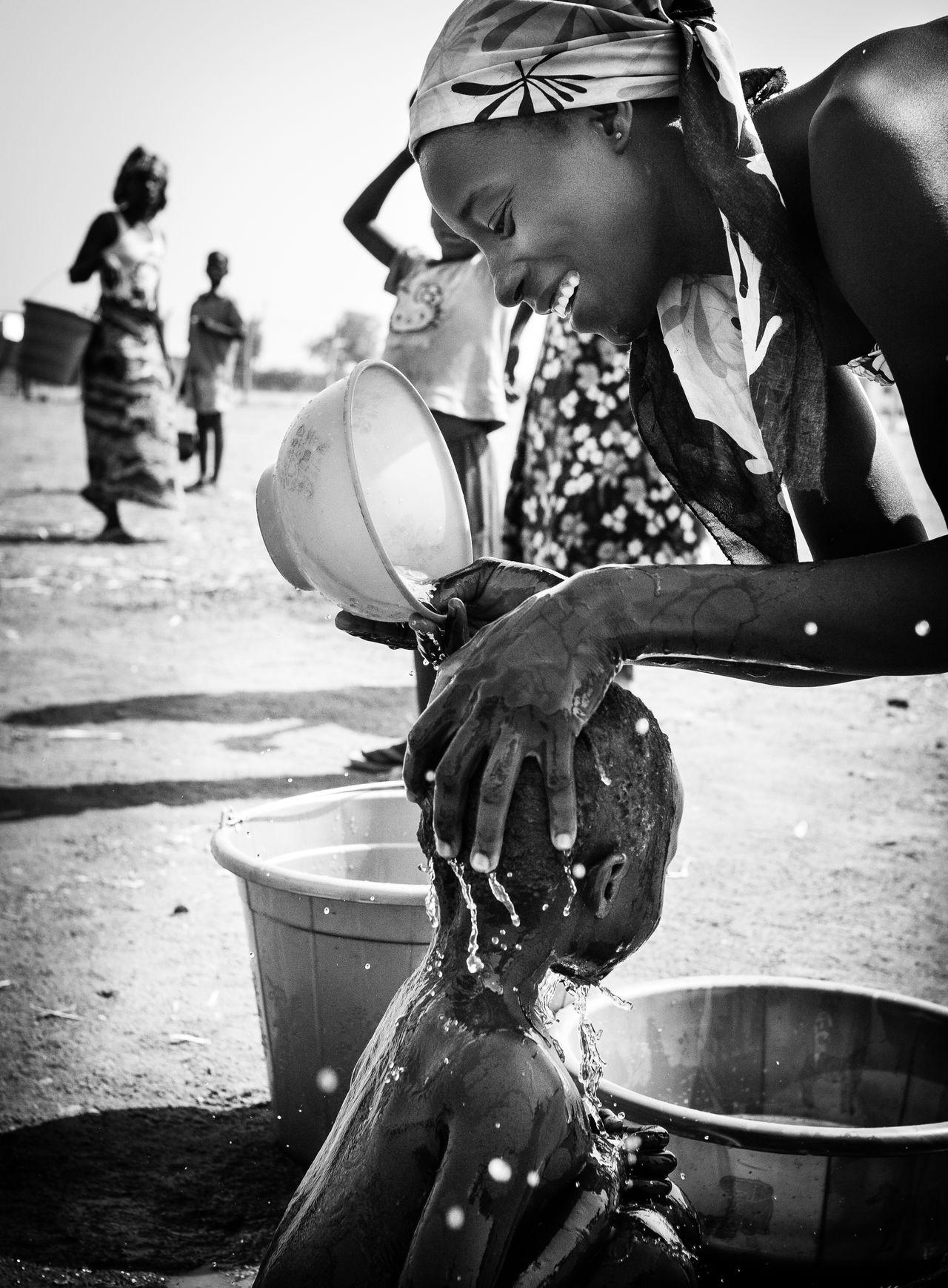 Taking Care Bathing Boko Haram Care EyeEm Best Shots EyEmNewHere Love Mother And Chils Nigeria Refugeecamp Refugees Crisis Terror The Photojournalist - 2017 EyeEm Awards Blackandwhite The Portraitist - 2017 EyeEm Awards Washing Yola