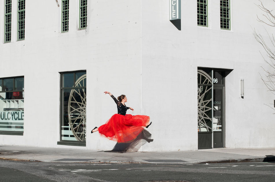 Let's all enjoy this day - no matter what. Architecture Building City Conceptual Dance Eye4photography  EyeEm Best Shots EyeEm Best Shots - Architecture EyeEm Gallery Full Length Jump One Person Outdoors People Real People Red Women