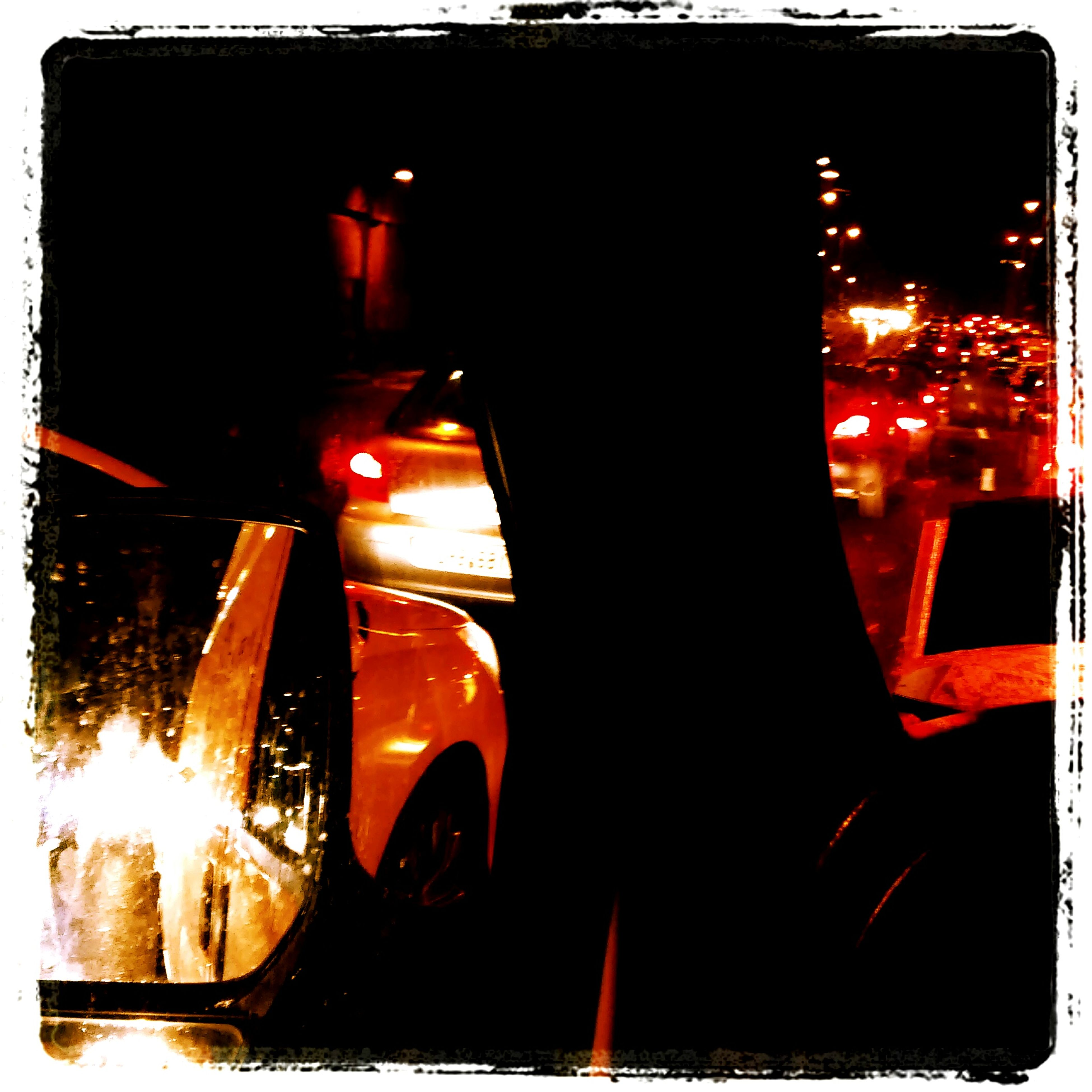illuminated, night, car, transportation, land vehicle, mode of transport, transfer print, street, street light, building exterior, auto post production filter, lighting equipment, headlight, glass - material, built structure, architecture, road, light - natural phenomenon, window, city