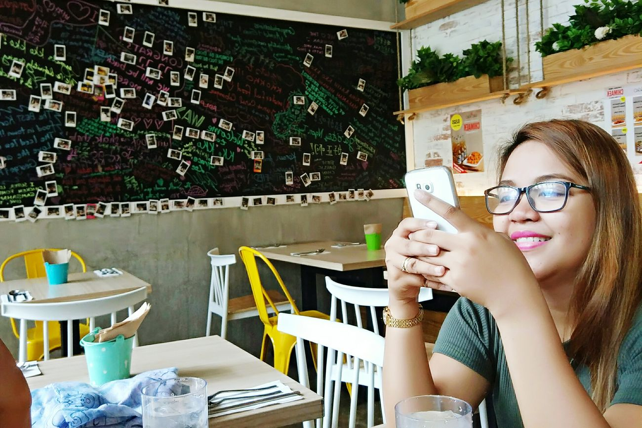 Mobile Conversations NewinEyeEm  One Young Woman Only Texting Smiling Message Board Tables Happiness Lovely Eye Glasses