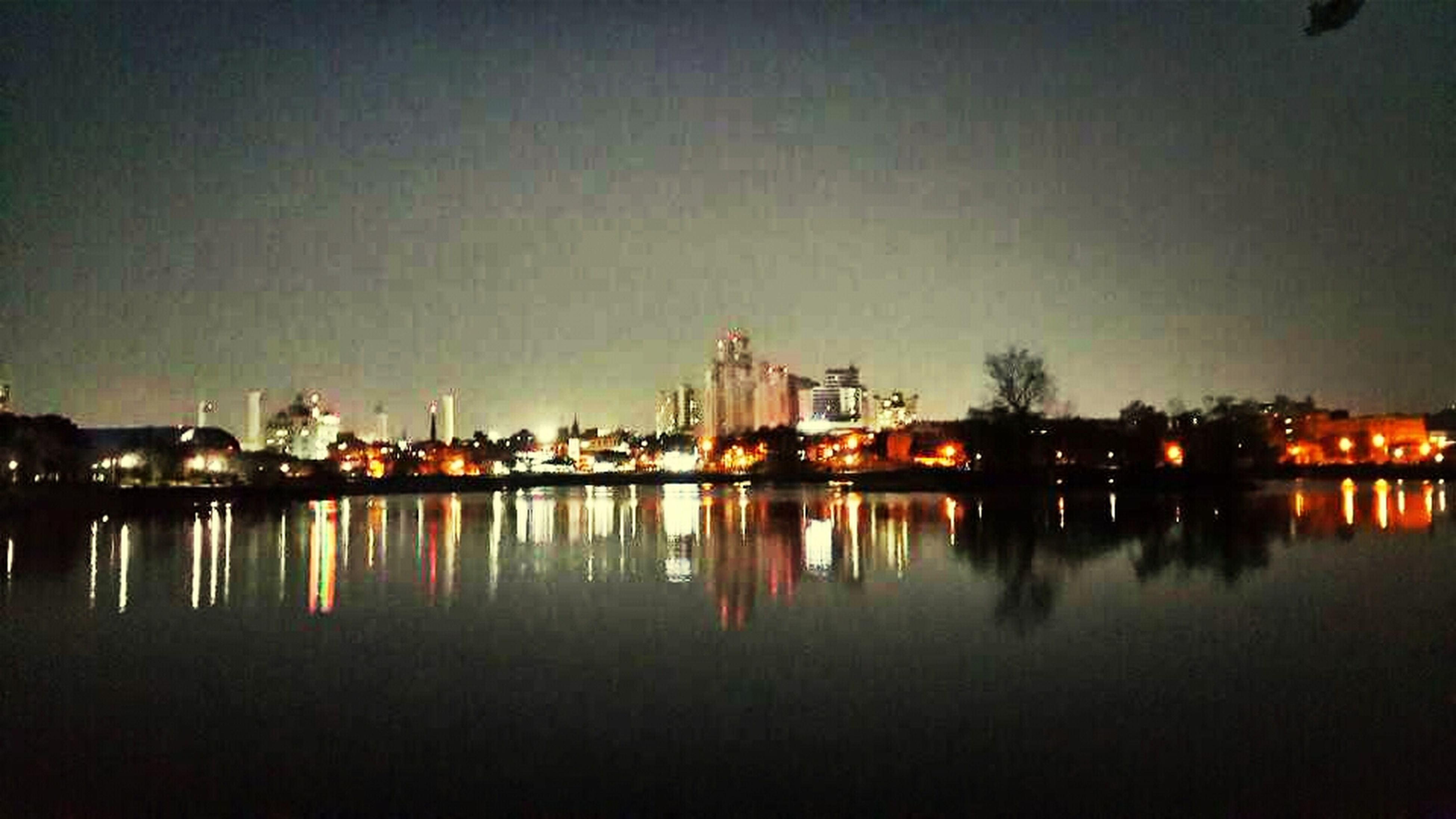 architecture, building exterior, built structure, water, illuminated, waterfront, reflection, night, clear sky, copy space, city, river, sky, dusk, lake, outdoors, no people, building, cityscape, residential structure