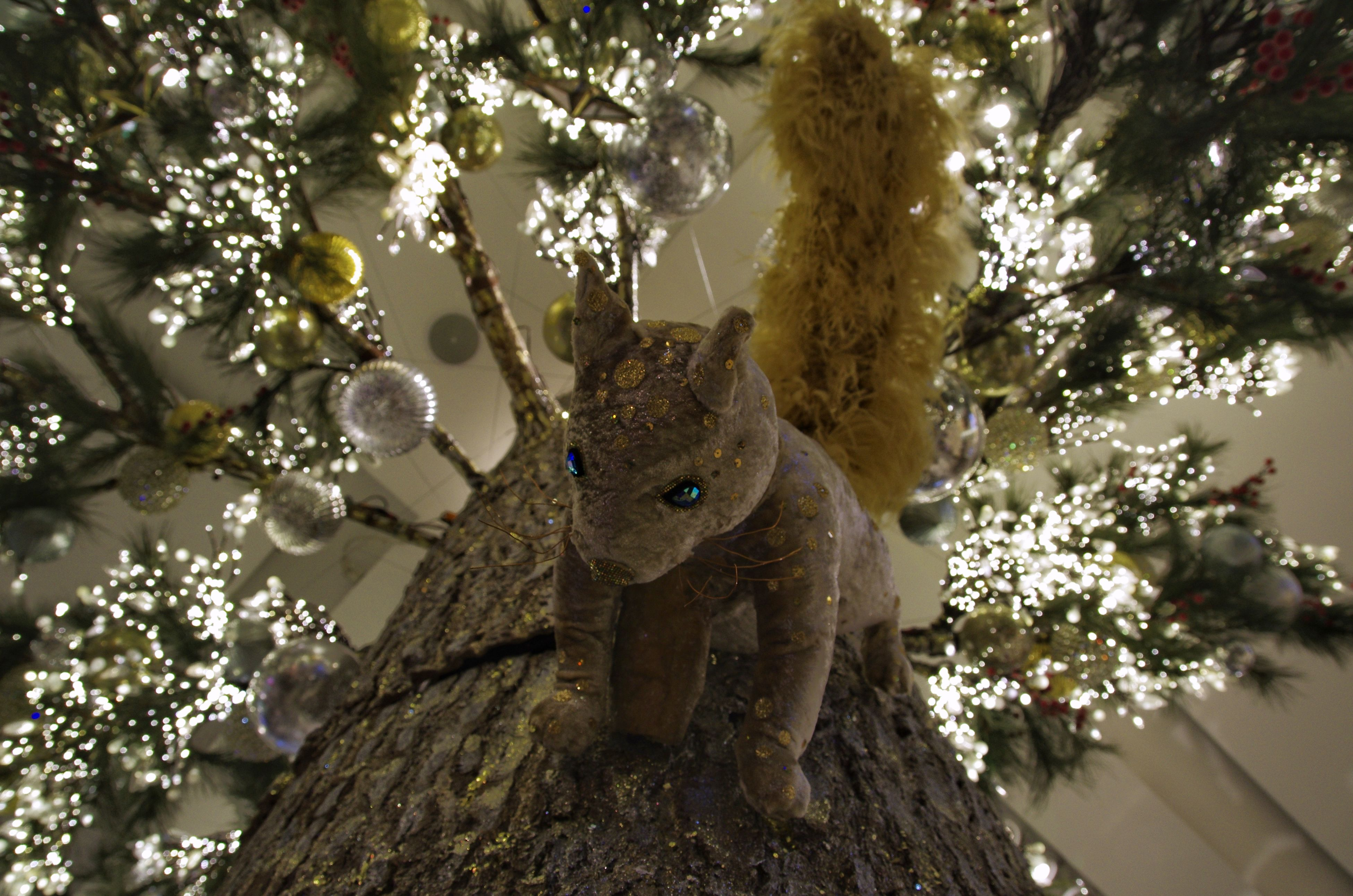 tree, no people, low angle view, nature, animal themes, sculpture, day, statue, outdoors, leopard