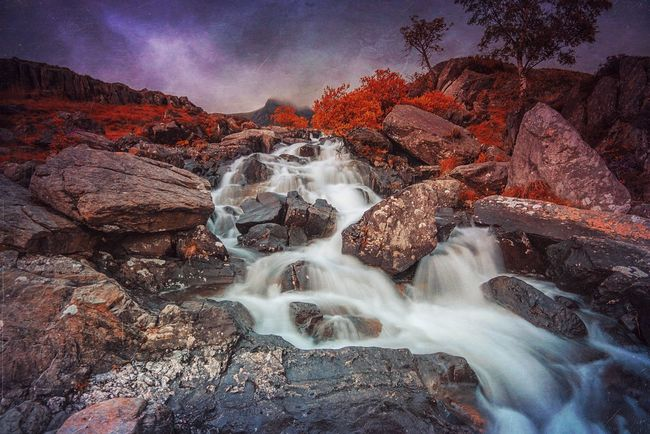 The Rocks & The Thunder | Snowdonia Wales Waterfall Moving Water Rocks And Water Beauty In Nature Mextures Landscape Photography Wild Mysterious Landscape Long Exposure Clouds And Sky Purple Sky Waterscape Waterfalls Beautiful Nature Wild Landscape Moody Sky Mountains The Great Outdoors With Adobe The Great Outdoors - 2016 EyeEm Awards