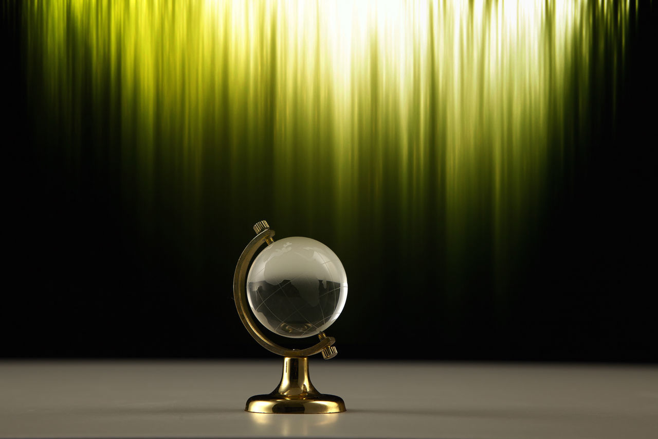 glass globe with green light Abstract Africa Beam Business Concept Crystal Curtain Glass Globe Green Lifestyles Lit No People Planet Ray Single Object Transparent World Map