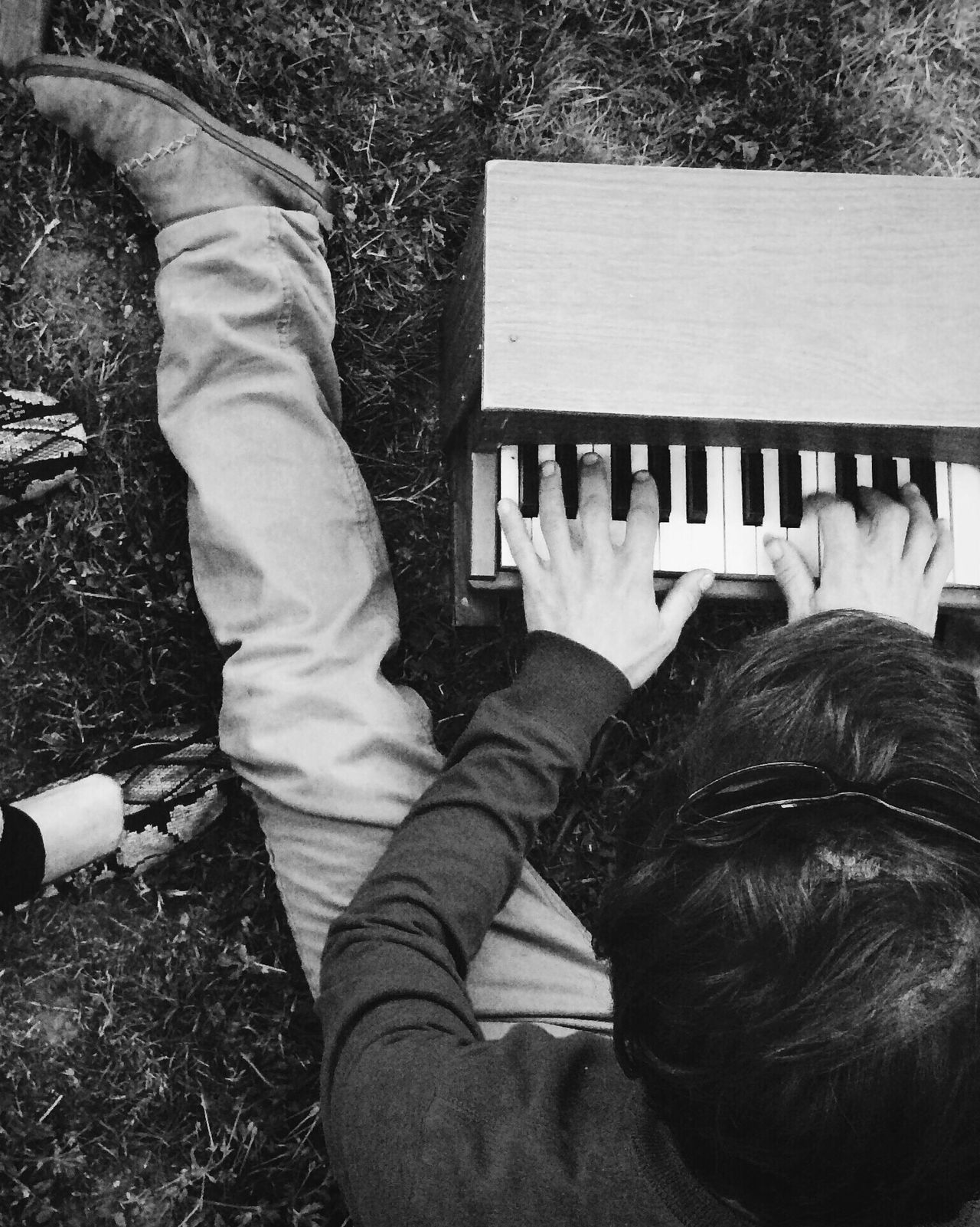 High Angle View Real People Low Section Lifestyles One Person Leisure Activity Day Men Outdoors Human Leg Close-up People Mini Piano Piano Piano Moments
