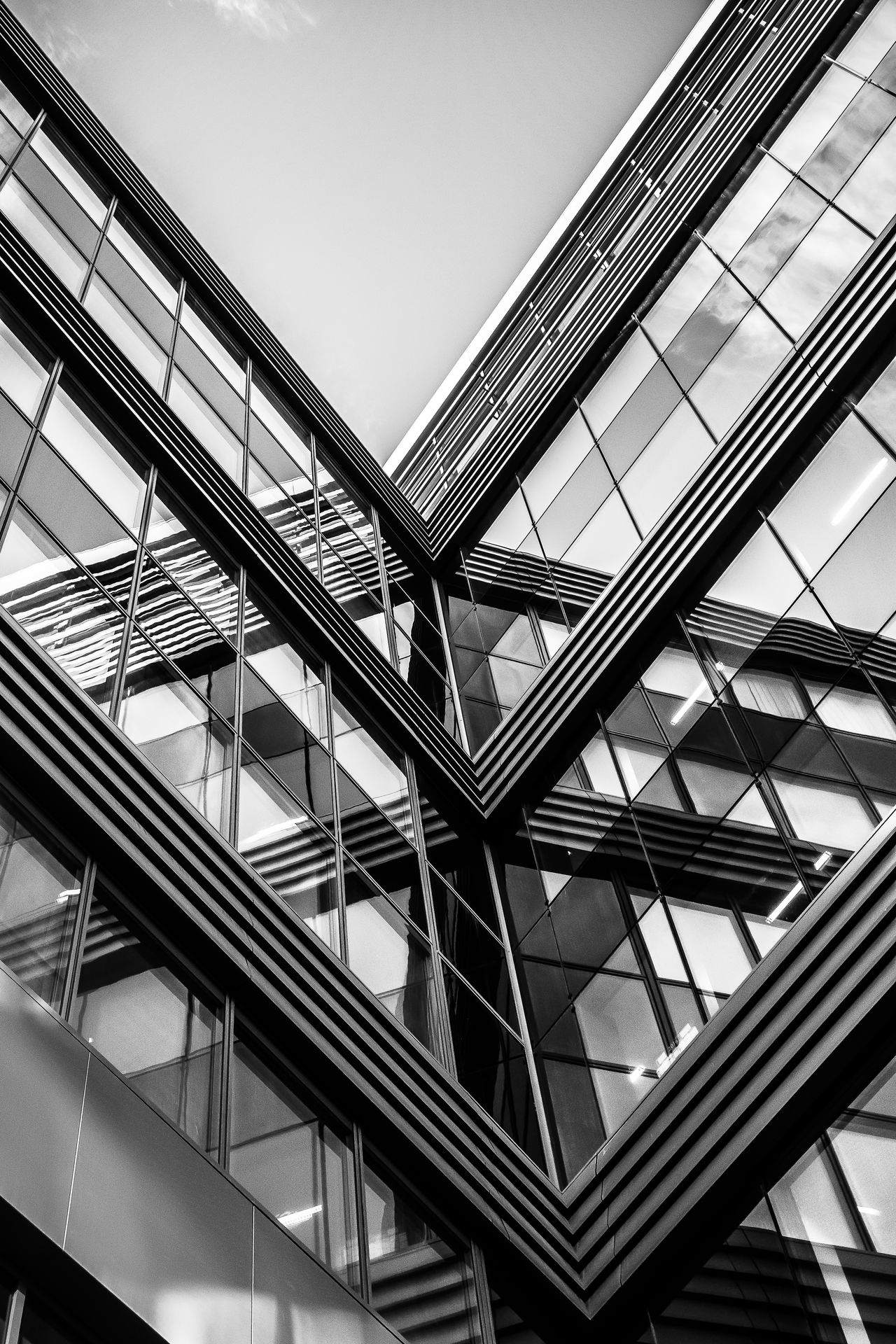 Monochrome Black And White Geometric Shapes Contrast Urban Geometry Angular Building From My Point Of View EyeEm Best Shots EyeEm Masterclass Reflections Massy Symmetry Symmetrical Abstract Pivotal Ideas Architectural Features Clear Sky TakeoverContrast