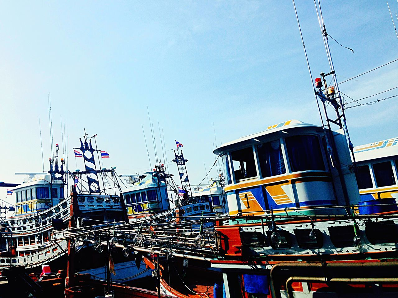 Low Angle View Of Boats Moored In Sea Against Sky