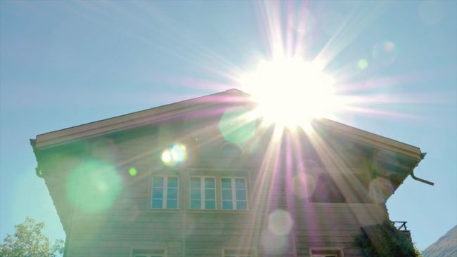Architecture Built Structure Building Exterior Sun Sunbeam Lens Flare Sunlight Low Angle View Window Switzerland Chalet House Clear Sky Sunny City Bright Outdoors Day Sky City Life Shining No People