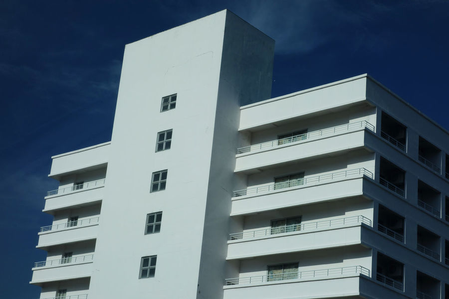 geometric shape white buildings against blue sky Architecture Blue Building Exterior Built Structure City Day Geometric Shape Low Angle View Modern No People Outdoors Residential  Sky Window