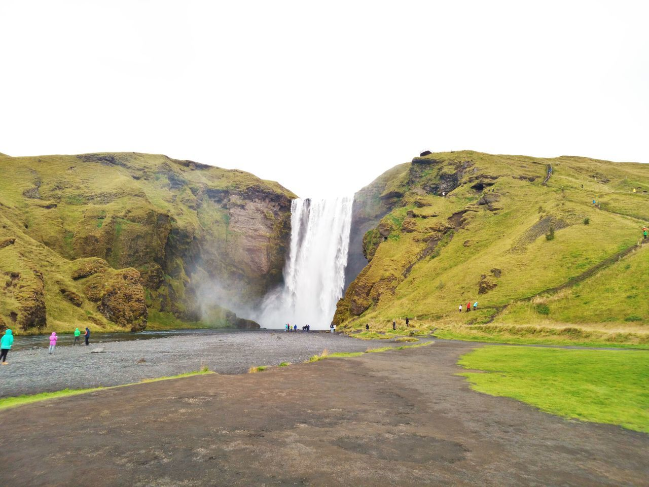 Skogafoss IslandeBeauty In Nature Cloud - Sky Geology Grass Island Landscape Mountain Nature Outdoors Sky Water Waterfall Stone Islandlife Islande Tranquility ROC Green Color Beautiful Icelandtrip Iceland_collection The Great Outdoors - 2017 EyeEm Awards Neighborhood Map Live For The Story