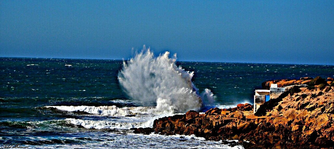 sea, water, horizon over water, nature, clear sky, beauty in nature, blue, motion, outdoors, scenics, day, power in nature, no people, sky, wave, force, crash