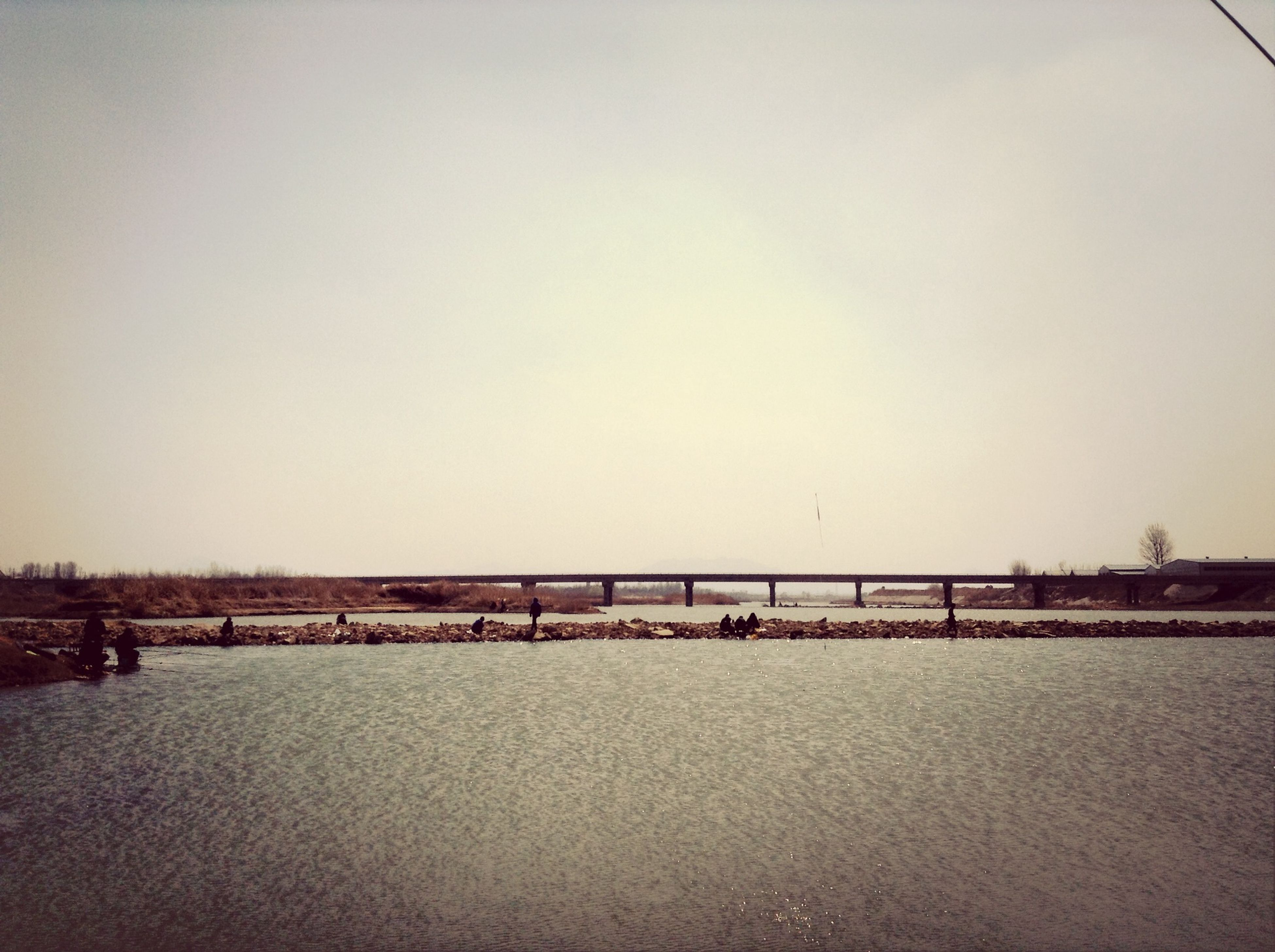 clear sky, copy space, connection, built structure, bridge - man made structure, architecture, water, tranquility, bridge, tranquil scene, nature, outdoors, transportation, scenics, no people, engineering, day, sky, beauty in nature, long