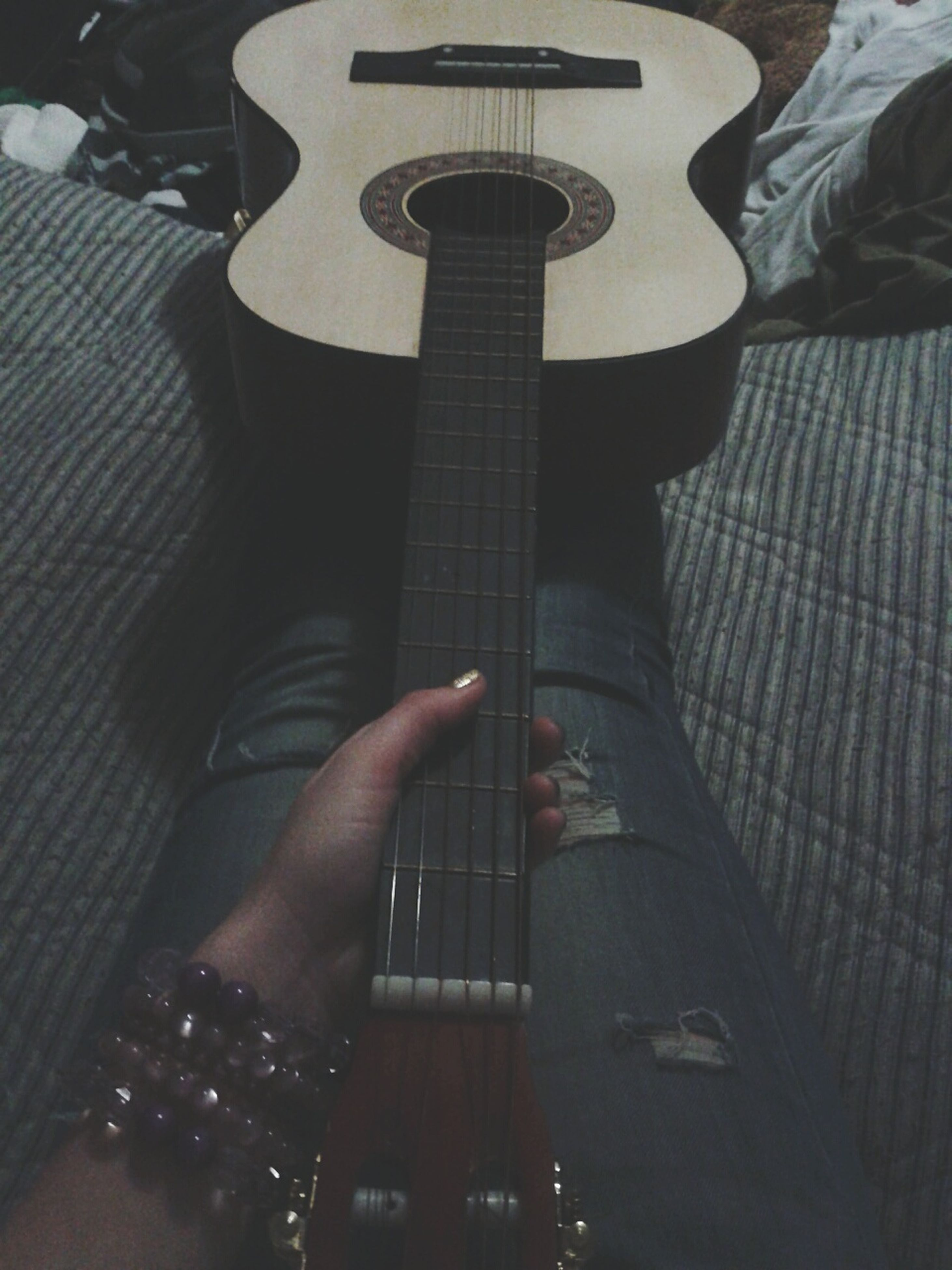 lifestyles, person, leisure activity, indoors, music, part of, men, technology, high angle view, holding, arts culture and entertainment, personal perspective, musical instrument, unrecognizable person, guitar, communication