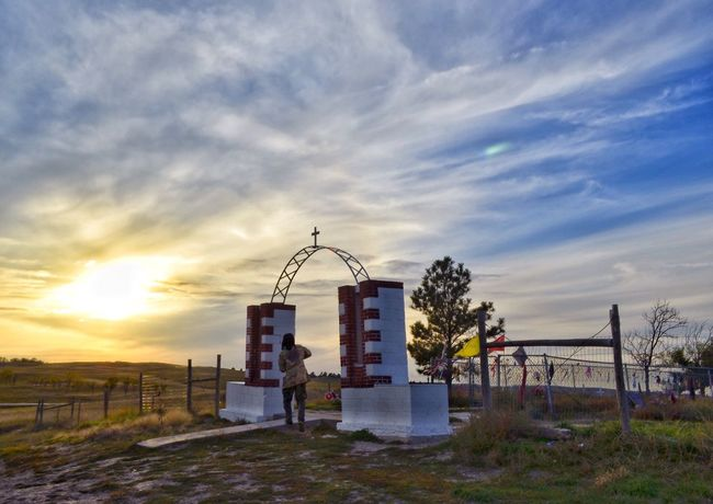 Sun Setting Near Wounded Knee Memorial Cemetery. Sunset Outdoors OglalaLakota First Nations Indigenous  Native American Cultures Tradition Wounded Knee Pine Ridge Reservation Chief Big Foot