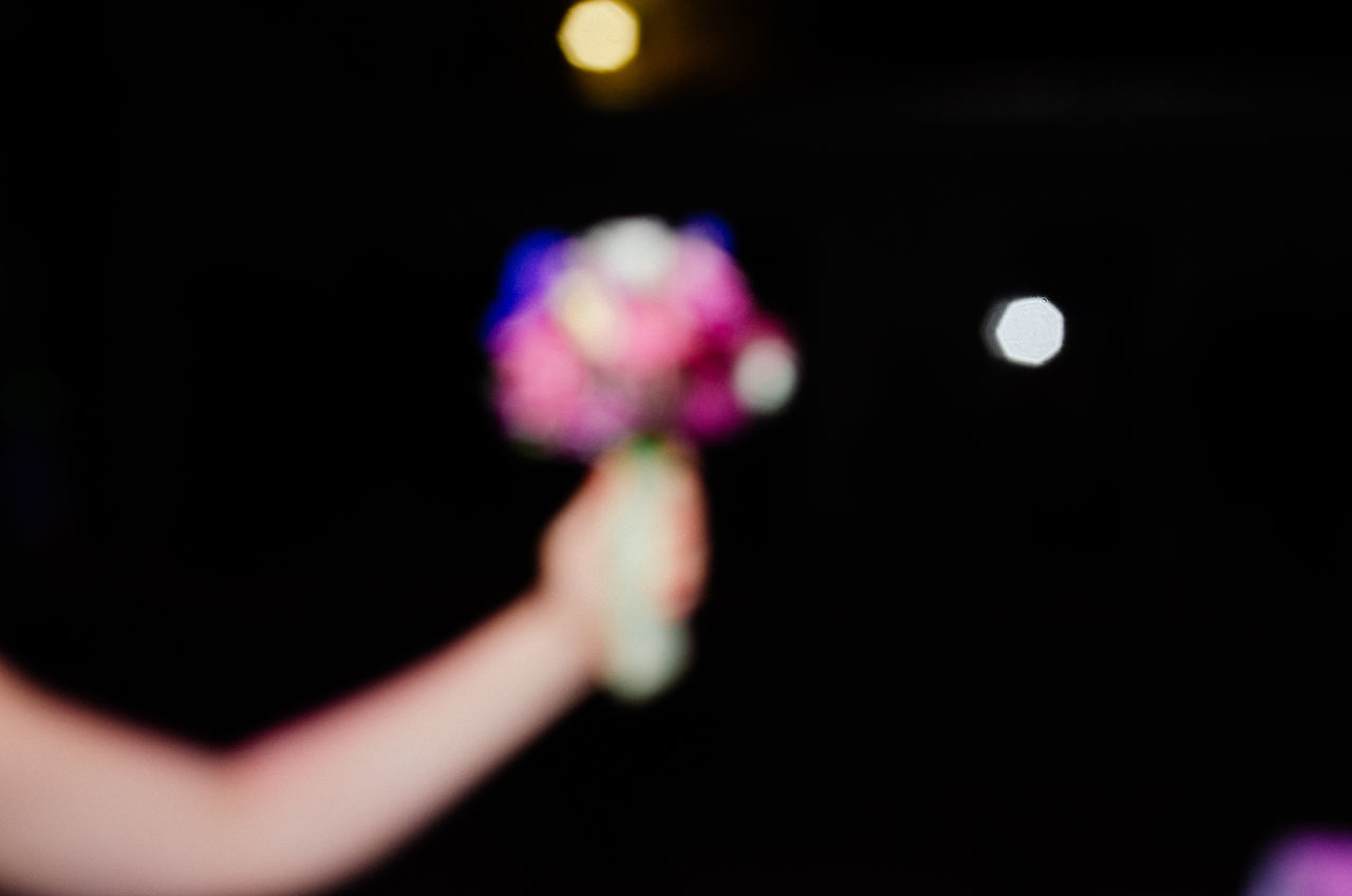 Art Artistic Black Background Blur Blurred Blurred Visions Blurry Bokeh Celebration Defocused Experimental Flower Bouquet  Flowers Human Body Part Human Hand Illuminated One Person Out Of Control Out Of Focus Party Partying People Wedding Wedding Day Wedding Party