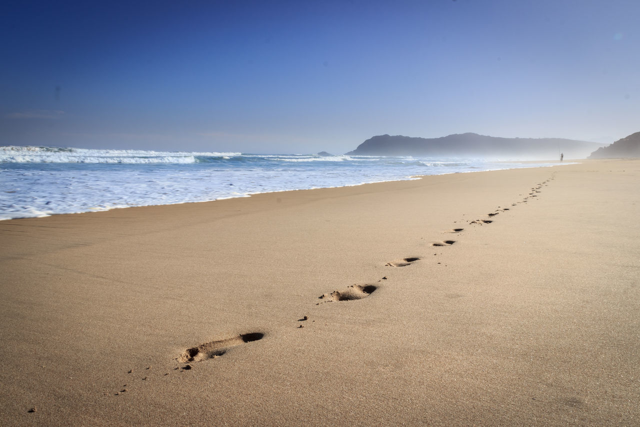 View Of Footprints On Sand At Beach