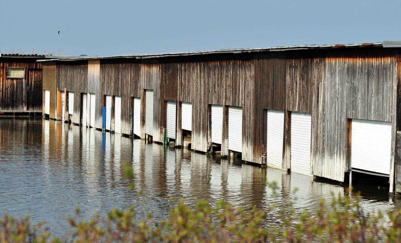 water, architecture, built structure, waterfront, day, no people, outdoors, building exterior, clear sky, corrugated iron, nature