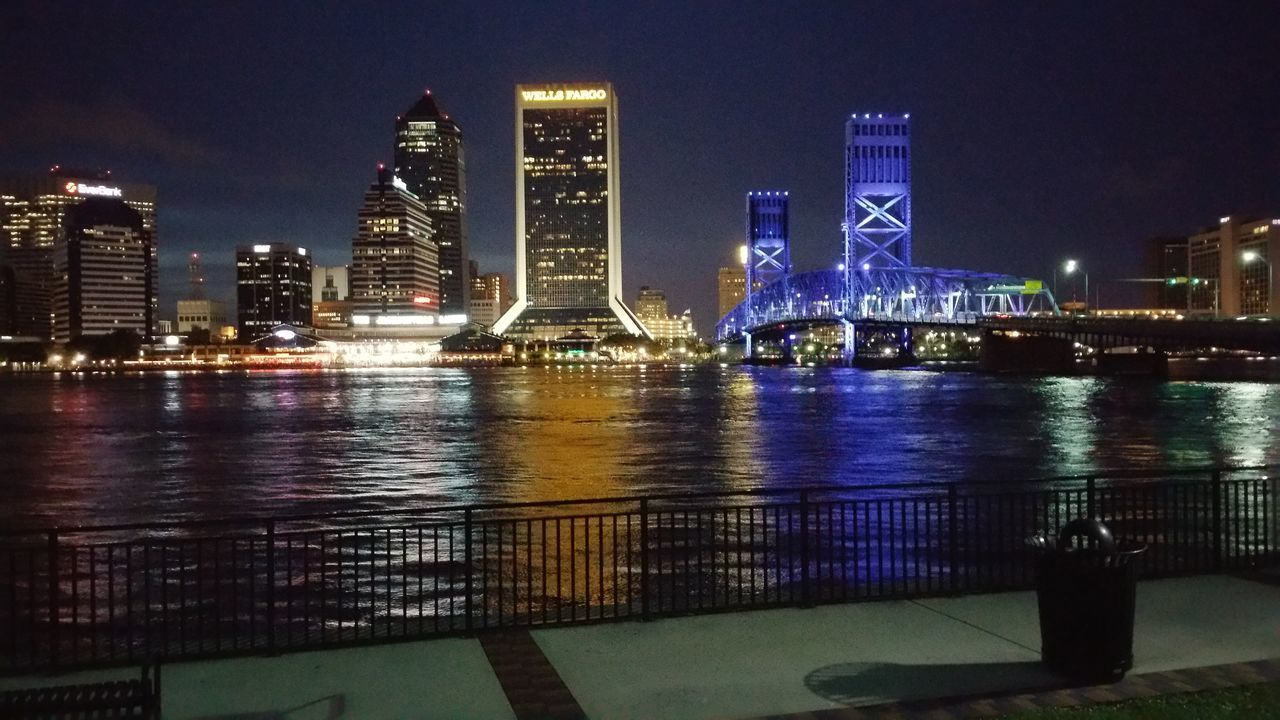 JacksonvilleFL Nightshot Downtown District Bridge Over Water Reflections Water Reflections Lights And Shadows Colorful Photo