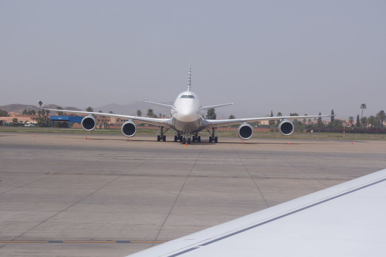 Aerospace Industry Air Vehicle Airplane Airport Airport Runway Arrival Boeing Commercial Airplane Day Landing - Touching Down Mode Of Transport No People Outdoors Passenger Boarding Bridge Sky Transportation Travel