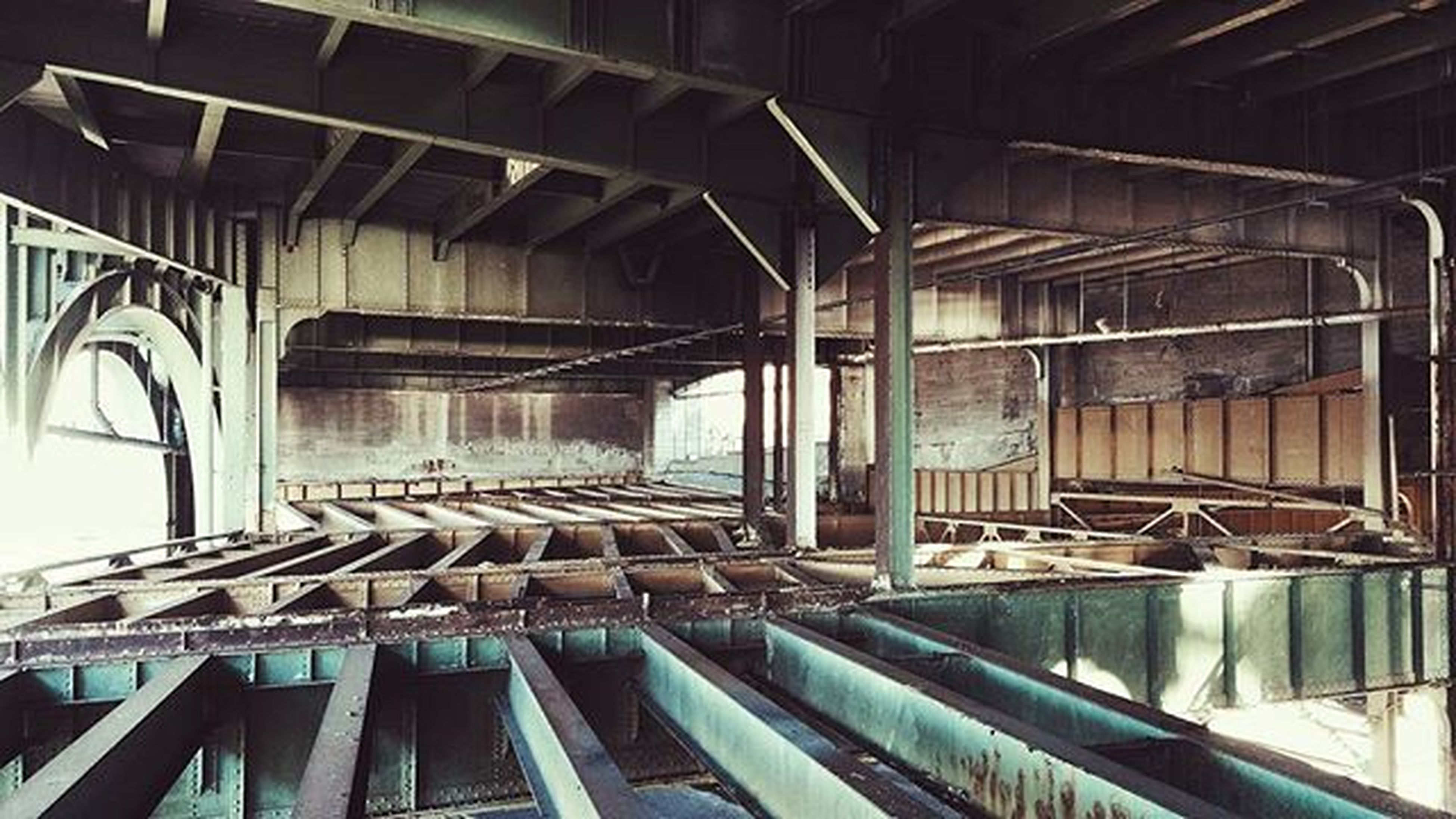 indoors, built structure, architecture, steps, staircase, railing, steps and staircases, wood - material, abandoned, absence, empty, old, interior, stairs, no people, day, window, building, ceiling, low angle view