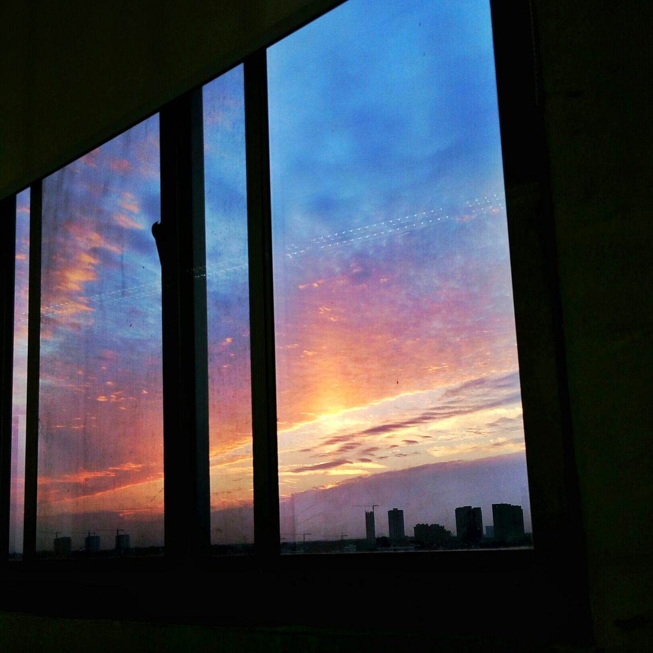 Sunset Window Architecture Sky Built Structure Cloud Silhouette Orange Color Scenics Indoors  Cloud - Sky Dark Geometric Shape Beauty In Nature Tall Moody Sky Nature Dramatic Sky No People Atmospheric Mood
