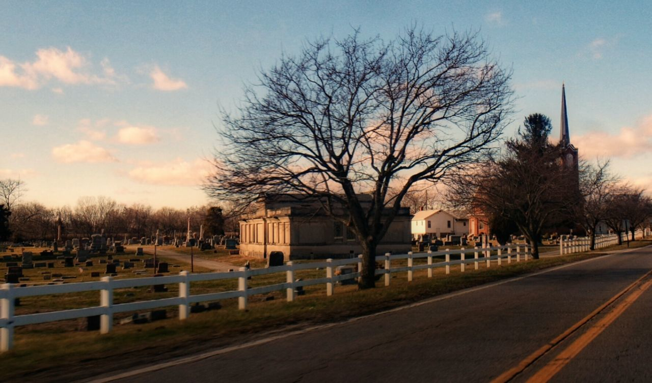 Small town cemetary Bare Tree Tree Sky Outdoors Road City No People Architecture Day Mausoleum Church Picket Fence Cemetery Cemetery Photography Headstones Headstones In A Row Roadway Built Structure Building Exterior Clouds, Nature, My View Obetz Ohio