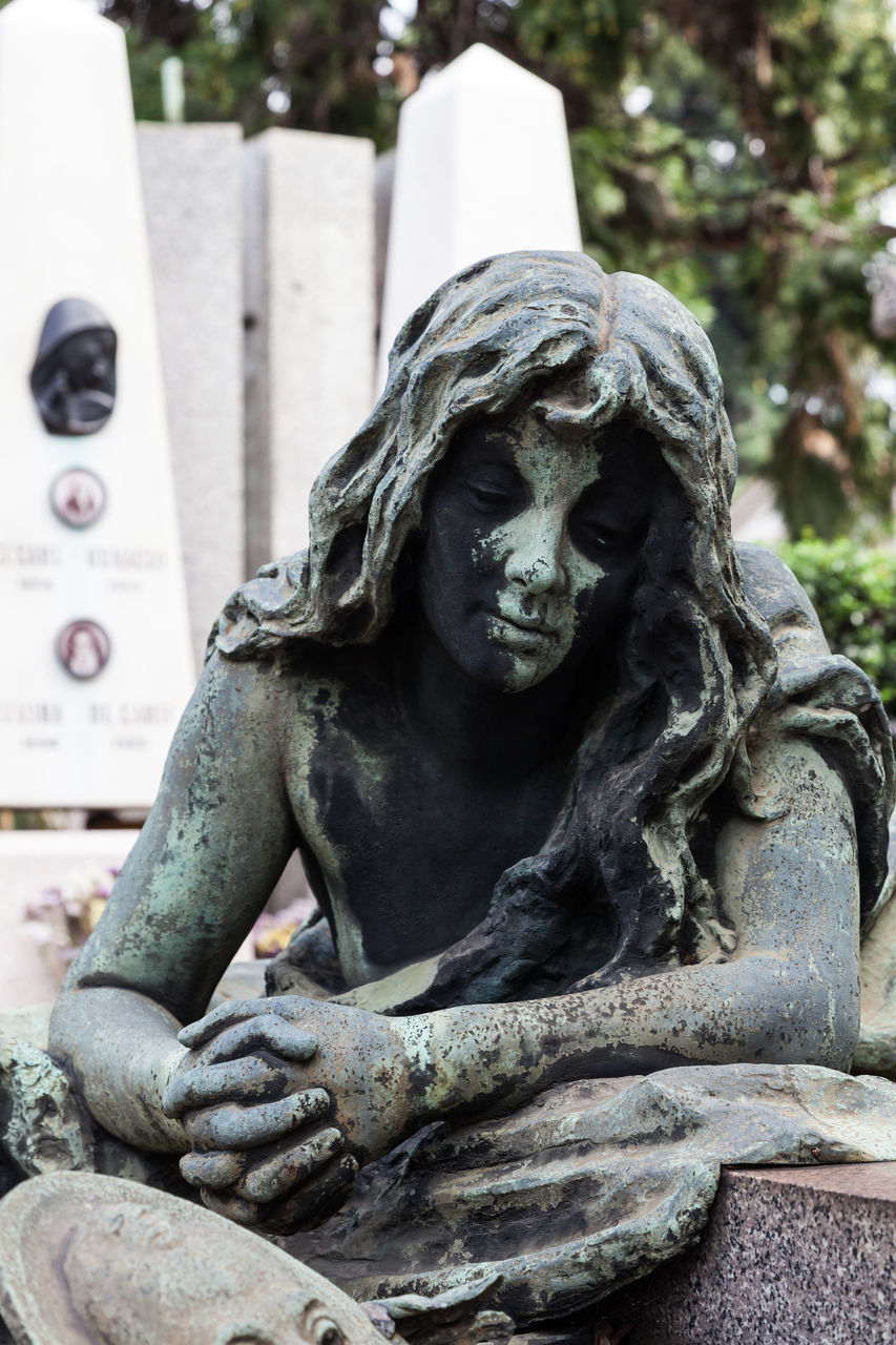 statue, cemetery, sculpture, art and craft, tombstone, sadness, memorial, human representation, creativity, stone material, no people, day, grief, outdoors, spirituality, graveyard, close-up