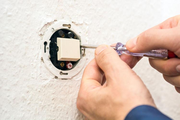 men repairing electric switch Repairing Repairs Switch Election Electrician  Electricity  Energy Nuclear Power In Nature Powerplant Whzz Up