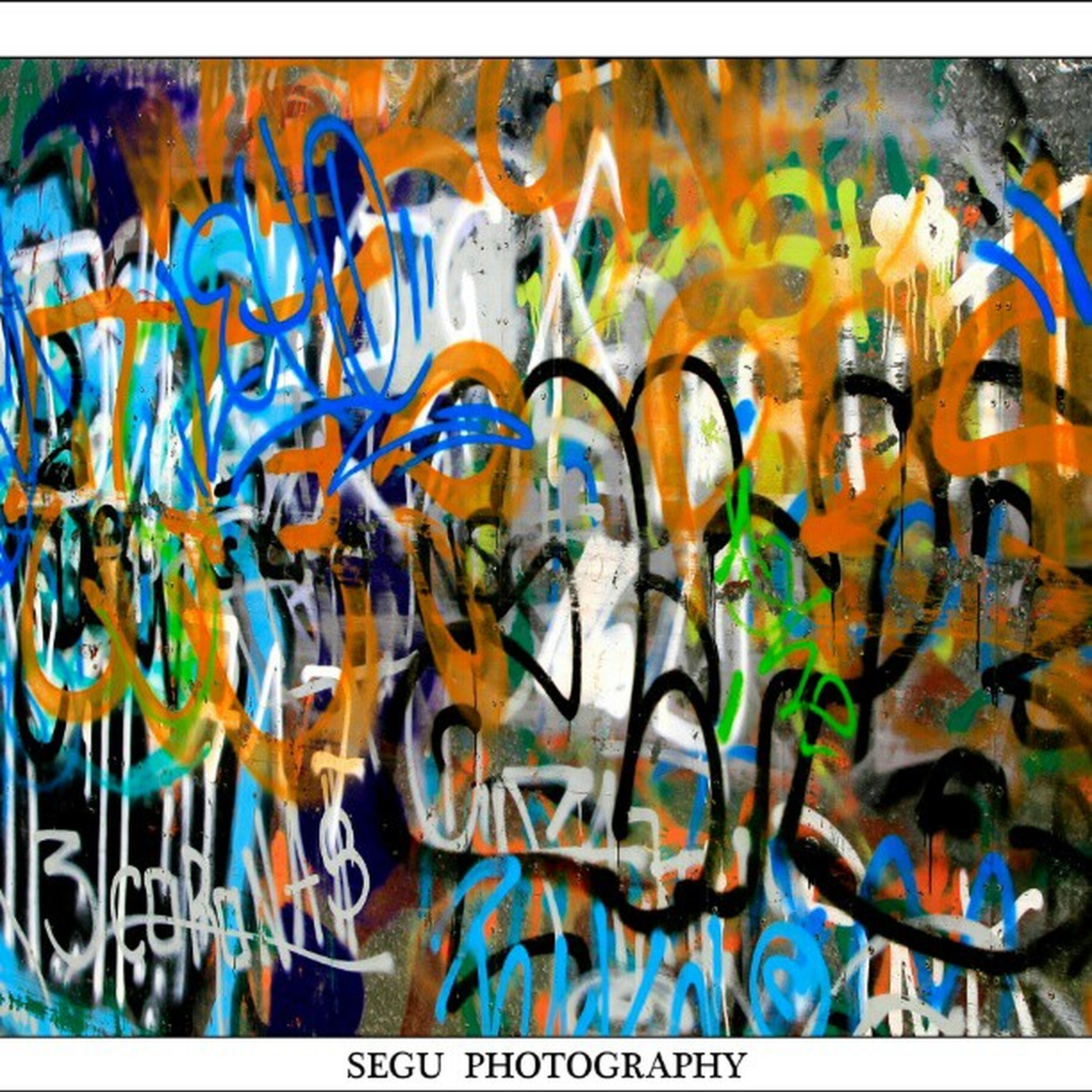 art, creativity, art and craft, graffiti, multi colored, text, human representation, street art, western script, wall - building feature, painting, mural, communication, animal representation, craft, colorful, design, blue