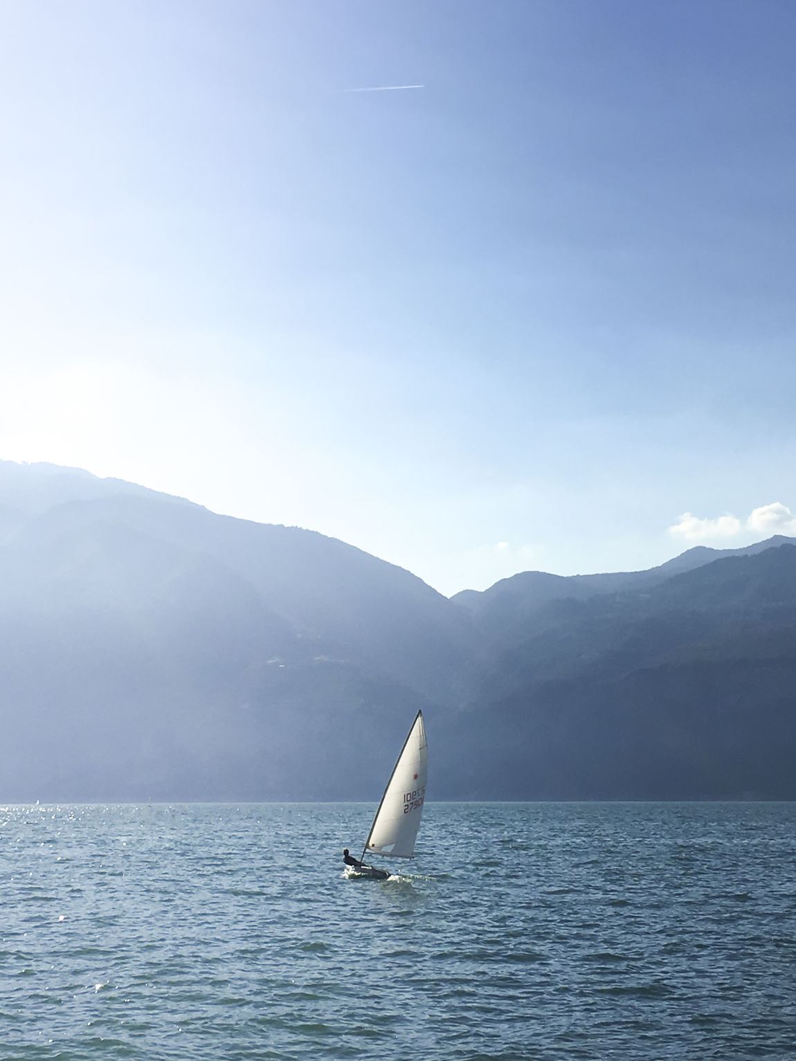 Sailing Beauty In Nature Boy Day Lake LakeGarda Laser Mountain Nature Outdoors Sailboot Sailing Scenics Sky Sunset Tranquility Travel Destinations Water Waterfront