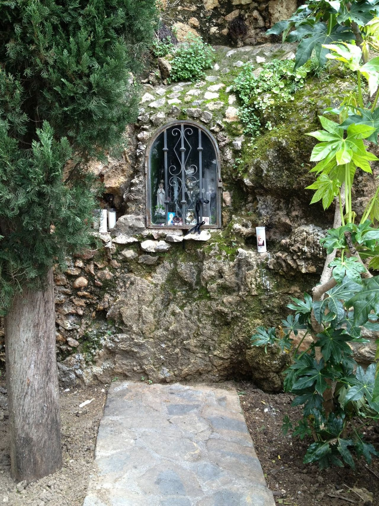 Day Ivy Nature No People Outdoors Plant Religious  Religious Architecture Statue Tree Architecture Tranquility Meditation Meditative Spot Sacred Shrine Shrine Gate Reflective Wall Wall - Building Feature Wall Art Stone Wall Stone Wall And Shrine Wall With Insert Shrine Collection