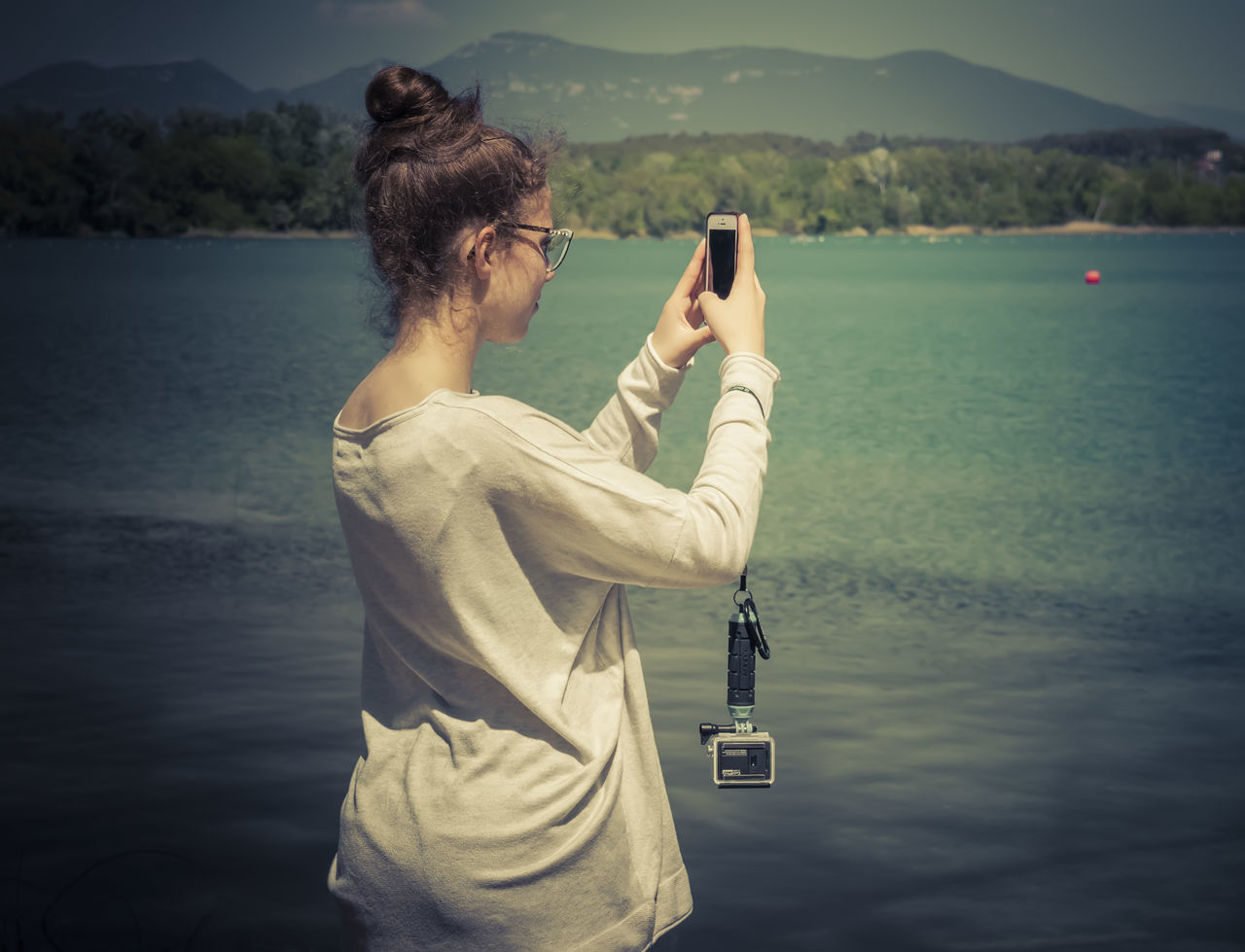 Smartphone photo Beauty In Nature Communication Day Lake Mobile Phone Nature One Person Outdoors People Photographing Portable Information Device Real People Smartphone Standing Technology Water Wireless Technology Young Adult