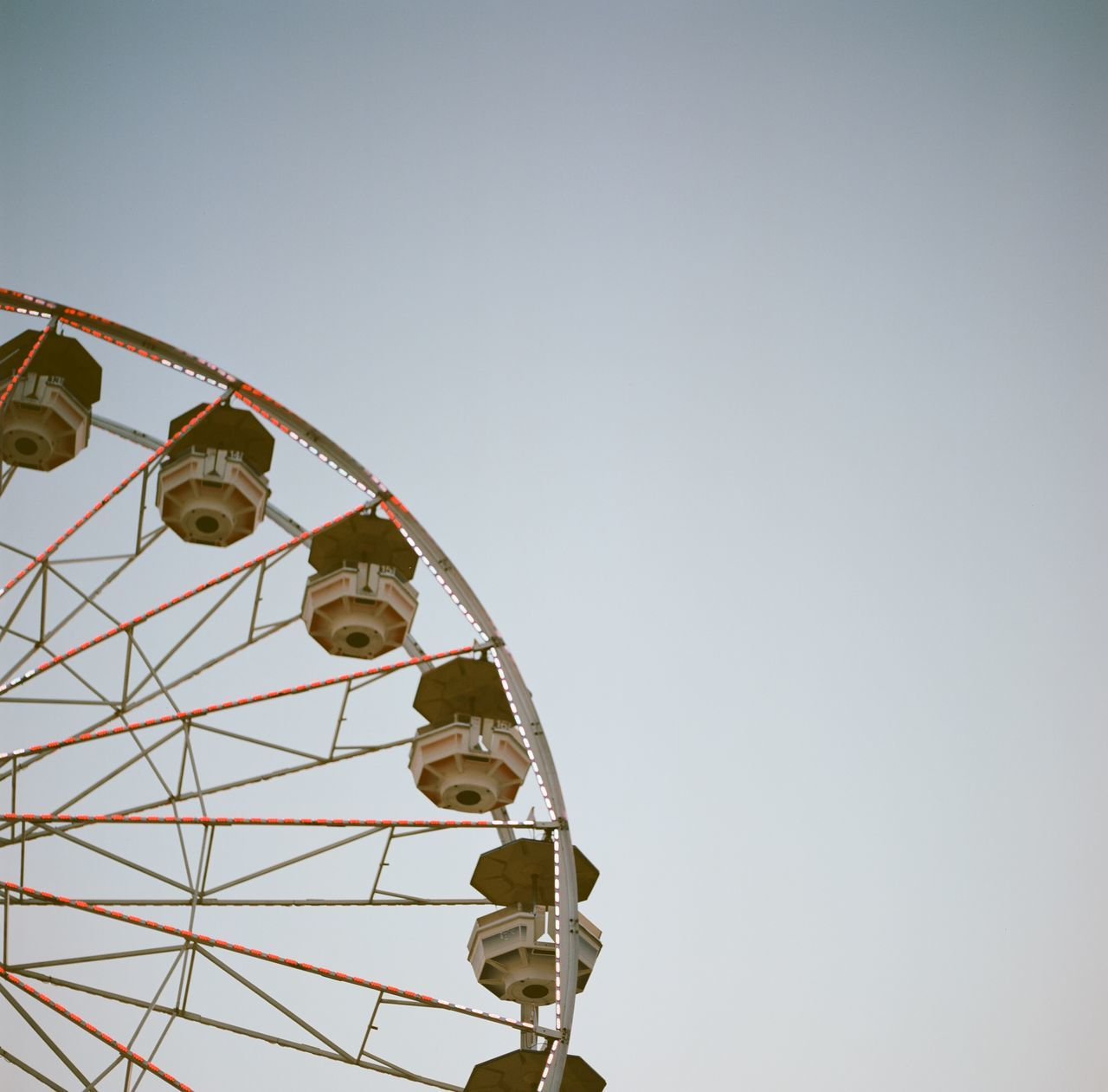 Cropped Image Of Ferris Wheel Against Clear Sky