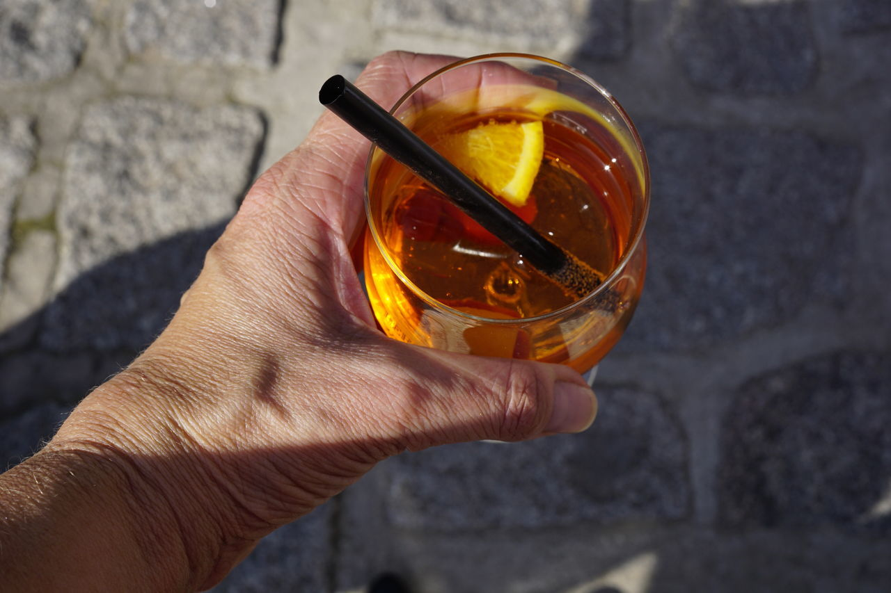 lets have a Drink Aperol Spritz Yummy Food Drink Have A Drink Human Body Part From Above  Fullframe