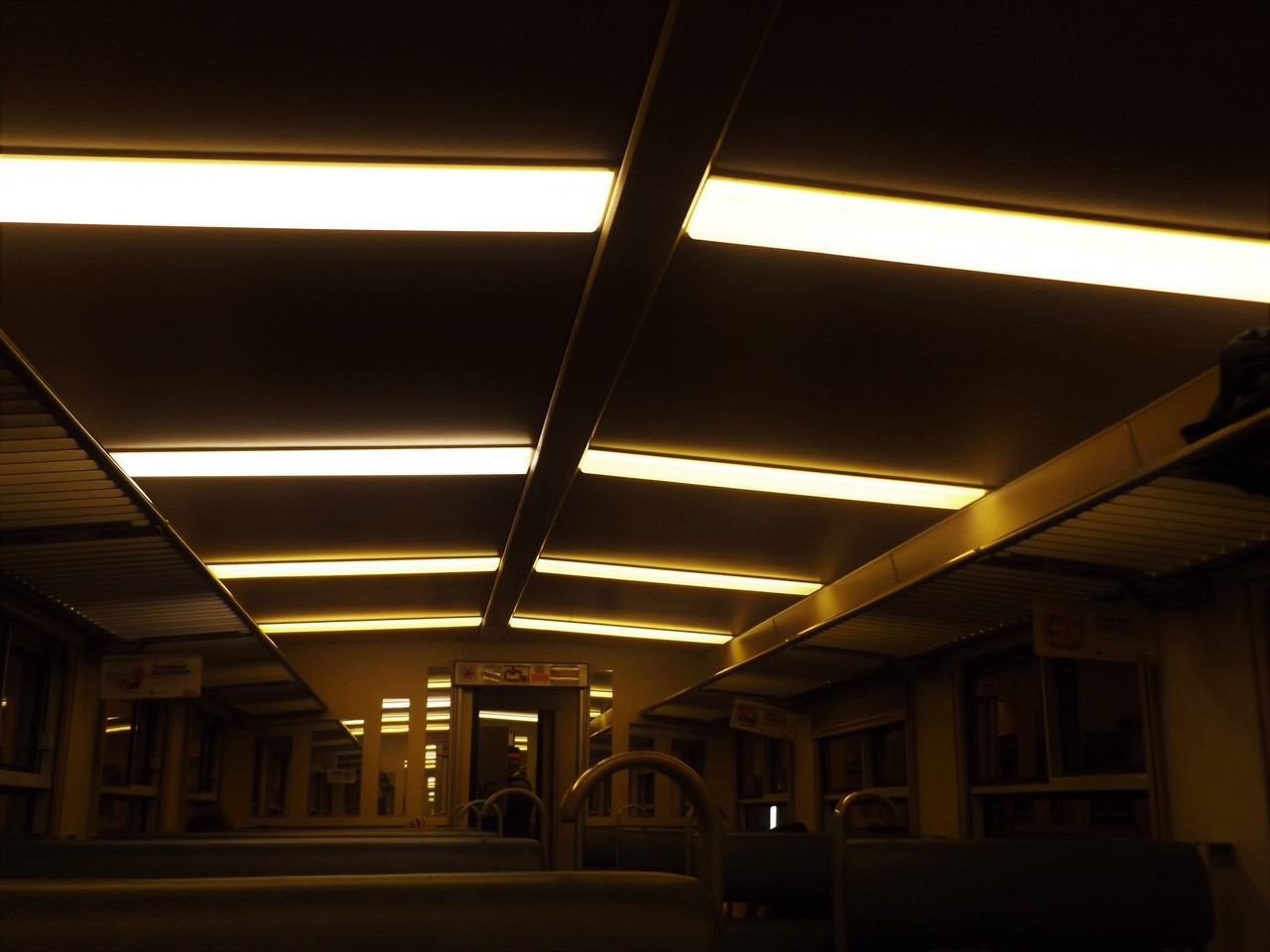 Lit. Low Light No Edit/no Filter Ceiling Dark Design Train On Board Diminishing Perspective Electric Lamp Electric Light Illuminated In A Row Interior Lamp Architecture Column Light Lighting Equipment Lit Modern Repetition The Way Forward Railway