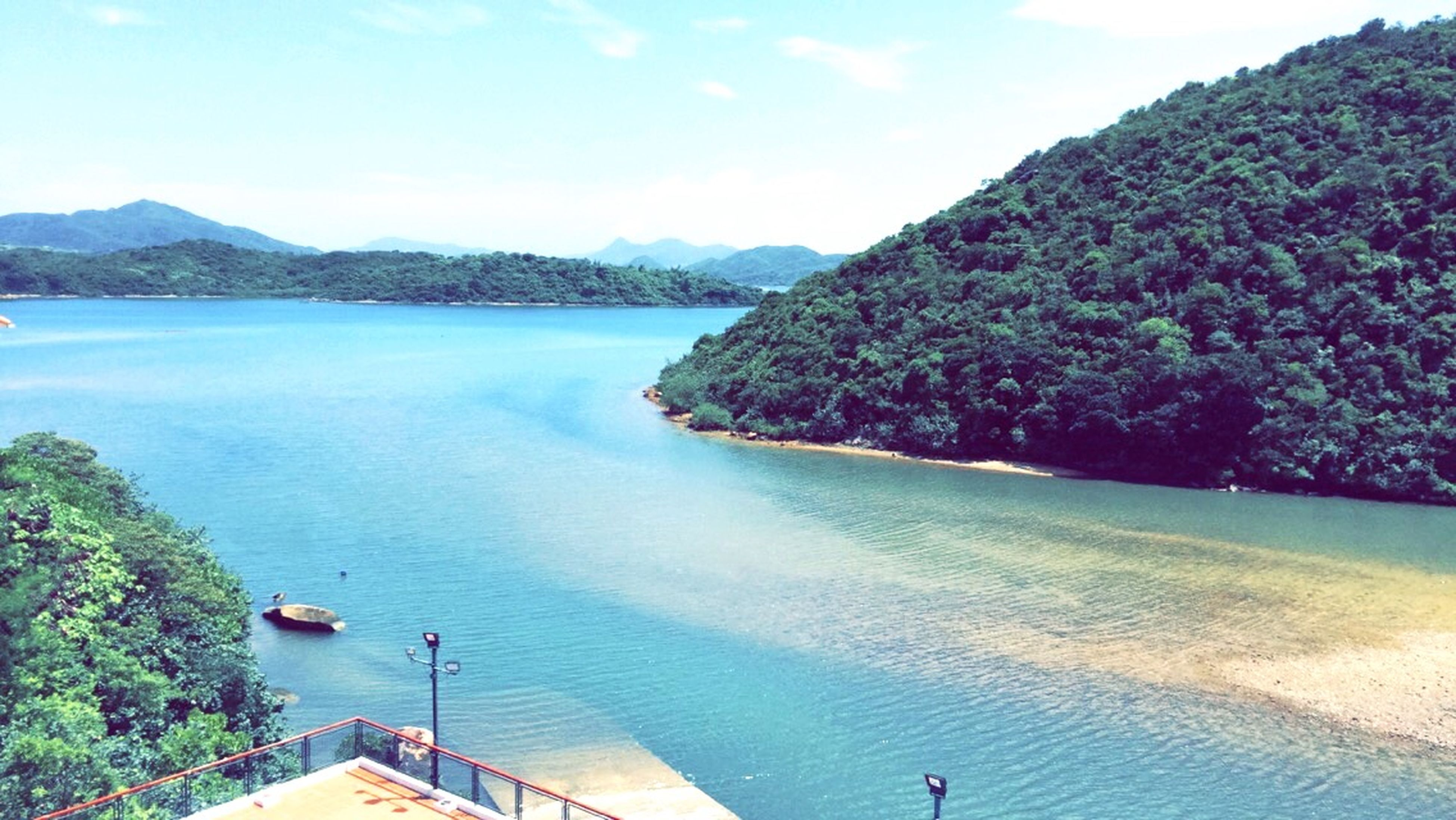 water, mountain, sea, scenics, tranquil scene, beauty in nature, tranquility, nautical vessel, sky, nature, blue, boat, tree, high angle view, idyllic, transportation, day, lake, mountain range, beach
