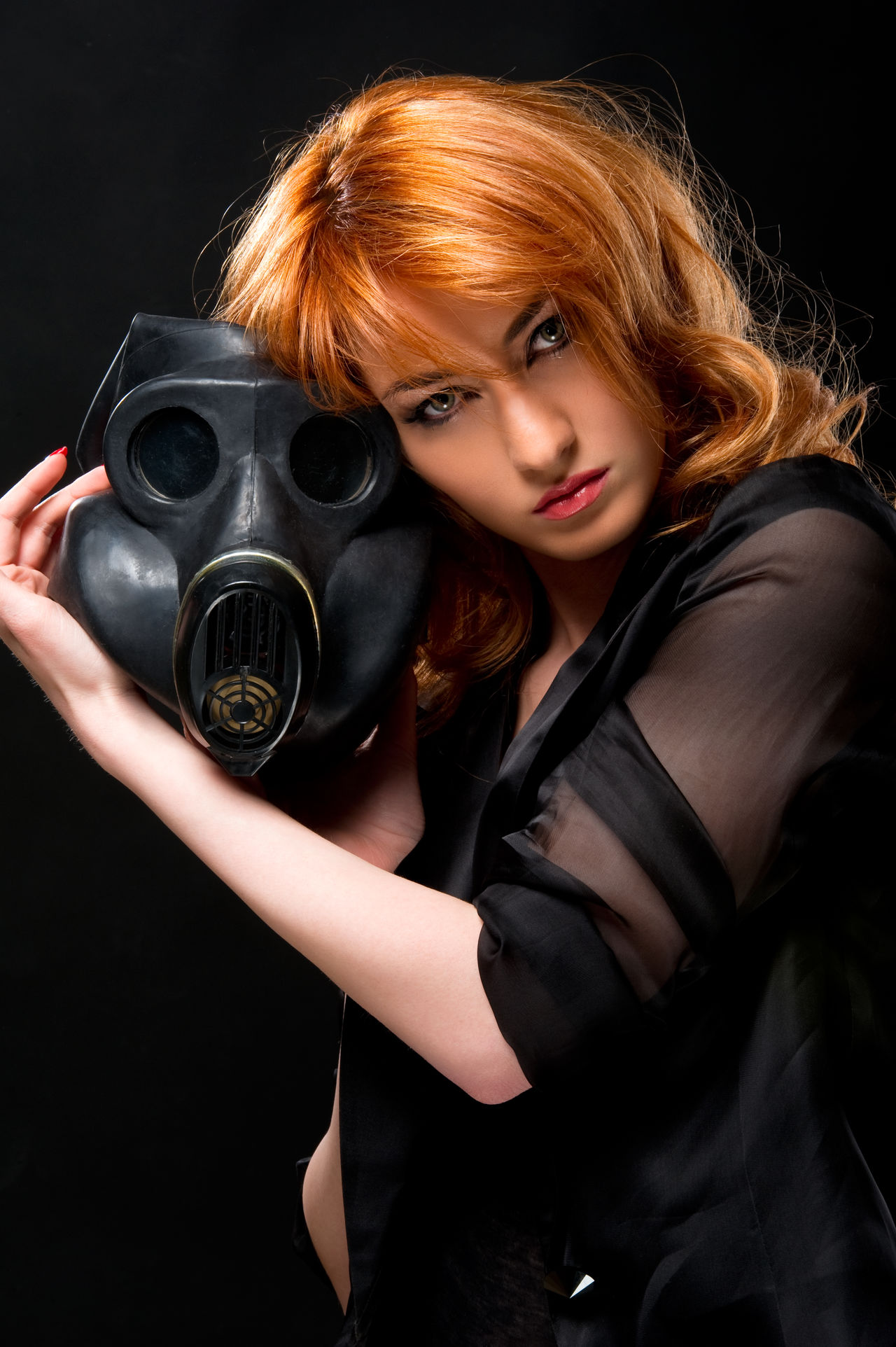Redhead woman holding gas mask Adult Attractive Beautiful People Beautiful Woman Black Background Caucasian Conceptual Face Female Gas Mask Girl Holding Looking At Camera One Person People Pollution Portrait Radiation Redhead Studio Shoot Studio Shot Woman Young