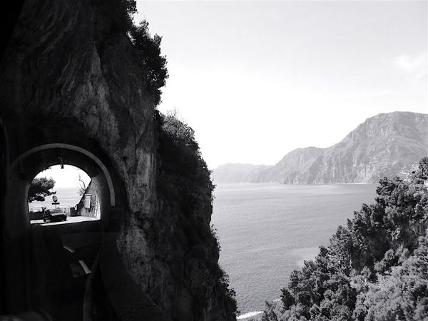 Bnw_friday_eyeemchallenge Roadscapes Amalfi Coast Italy Tunnel Sea Car Blackandwhite