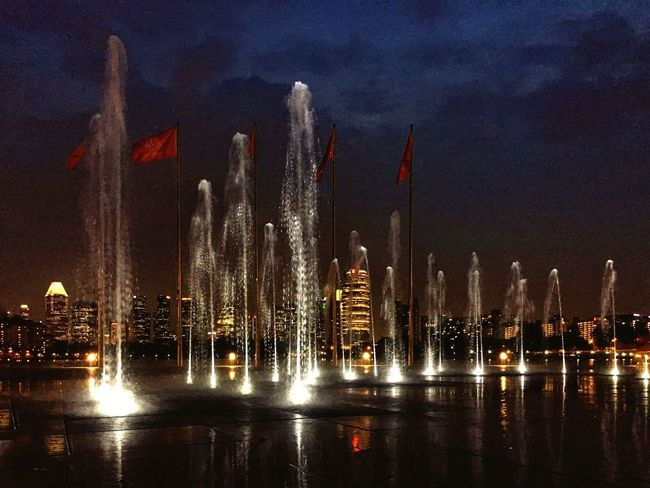 Life 2 Filter Illuminated Night City Cityscapes Building Exterior Architecture Built Structure Fountain Tall - High Glowing Tower Motion Low Angle View Light - Natural Phenomenon Travel Destinations Water Sky Urban Skyline Skyscraper Spraying Waterfront Nightphotography Night Lights Light
