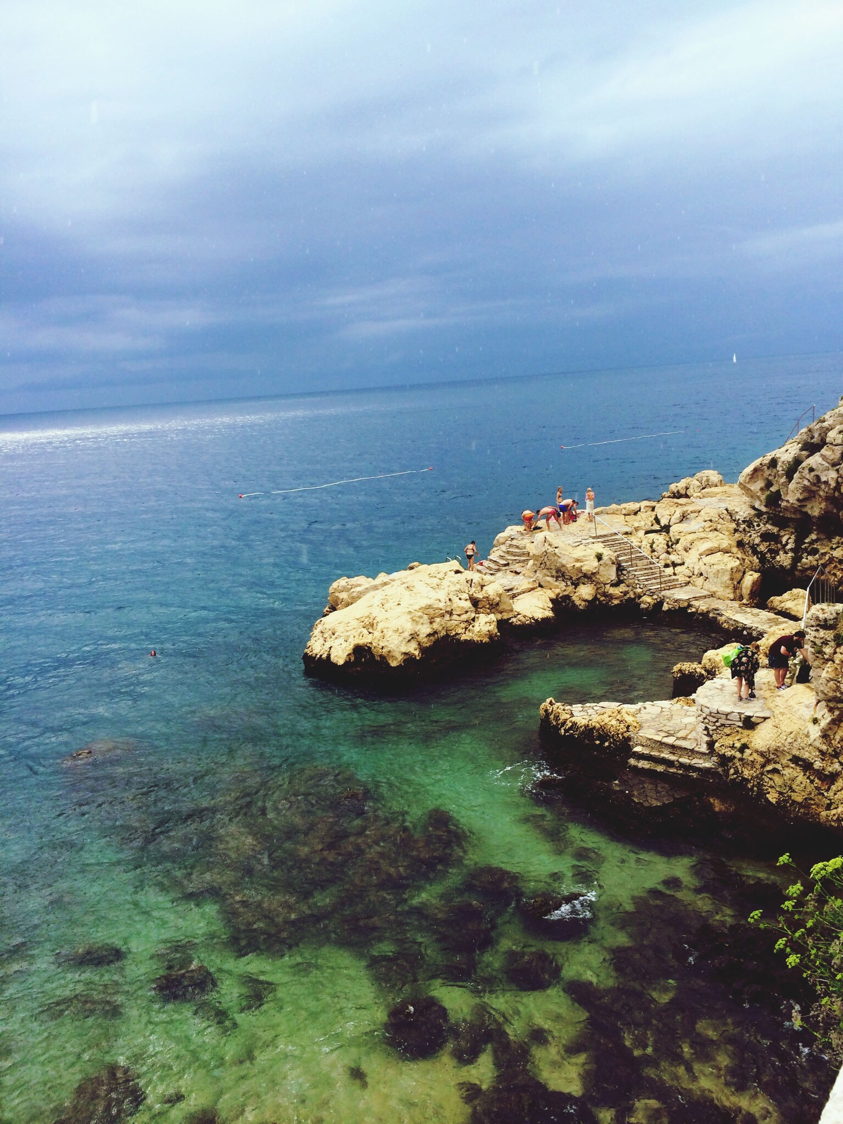 sea, horizon over water, water, tranquil scene, sky, scenics, tranquility, beauty in nature, cloud - sky, nature, idyllic, rock - object, beach, cloudy, coastline, cloud, seascape, shore, high angle view, remote