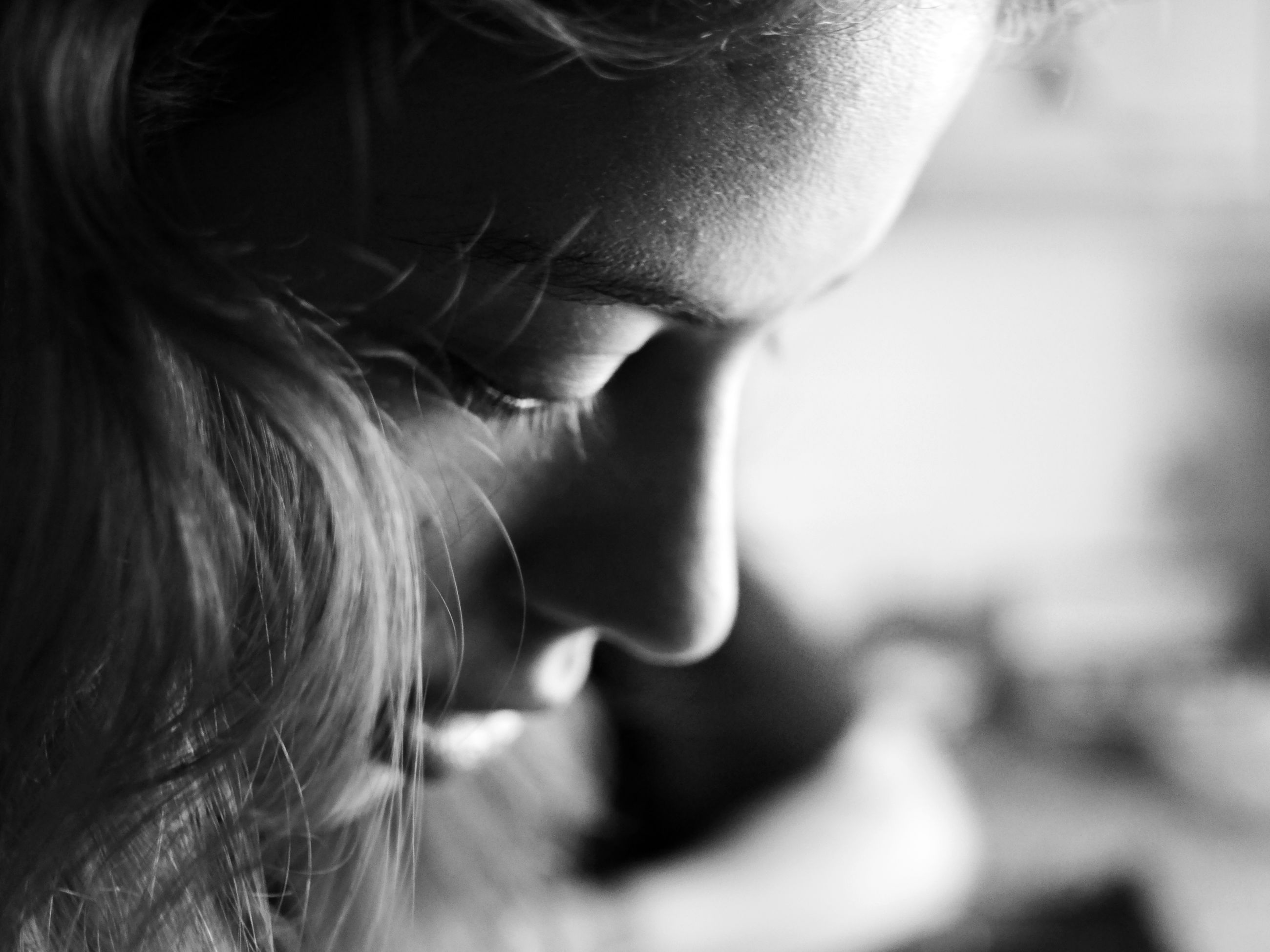 real people, one person, close-up, focus on foreground, human face, human body part, indoors, day