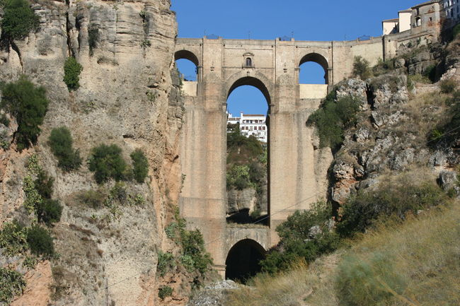 Ancient Arch Architectural Column Architecture Built Structure Day Grass Historic History Nature No People Old Old Ruin Outdoors Plant Sky The Past The Way Forward Tranquility Tree SPAIN Ronda Bridge Ronda Spain Fine Art Photography