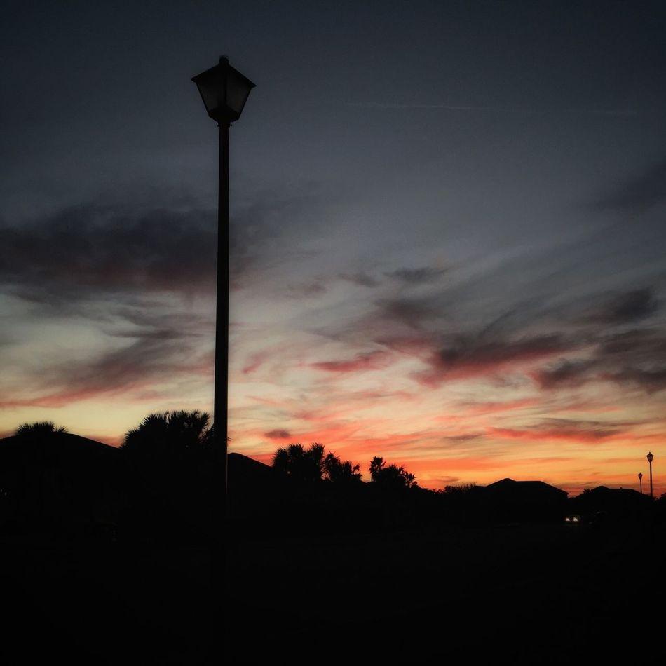 Lamp post sunset Sunset Silhouette Dramatic Sky Lamp Post Lamppost Street Lights At Sunset Urban Sunset Melbourne Beach, FL